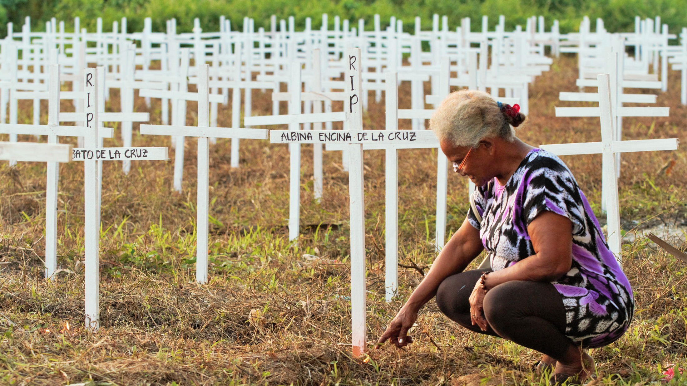 Tacloban, Philippines - A roadside memorial to the dead, a year after Haiyan