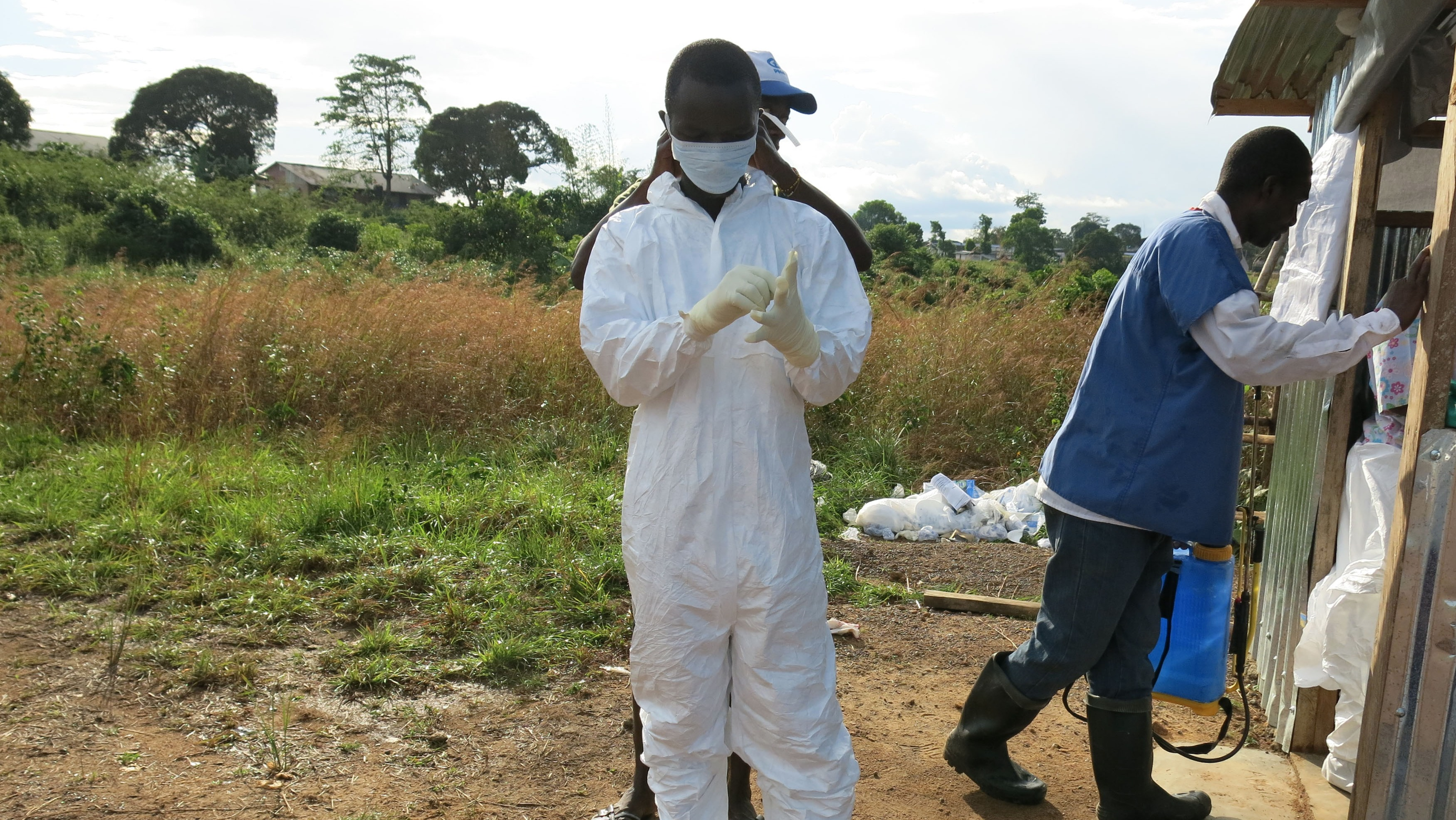Ebola survivor Tejani Golafelay prepares to go into the Bomi Ebola Treatment Unit in Liberia to help patients.