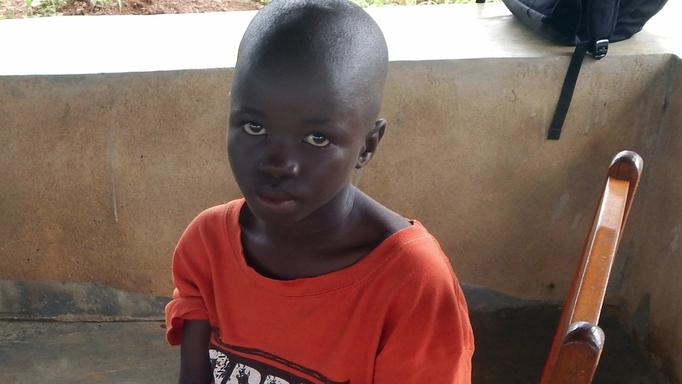 Lamin Borbor, 8, will live at the Interim Care Center for Ebola orphans in Kailahun town until social workers can reunite him with extended family or place him in foster care.