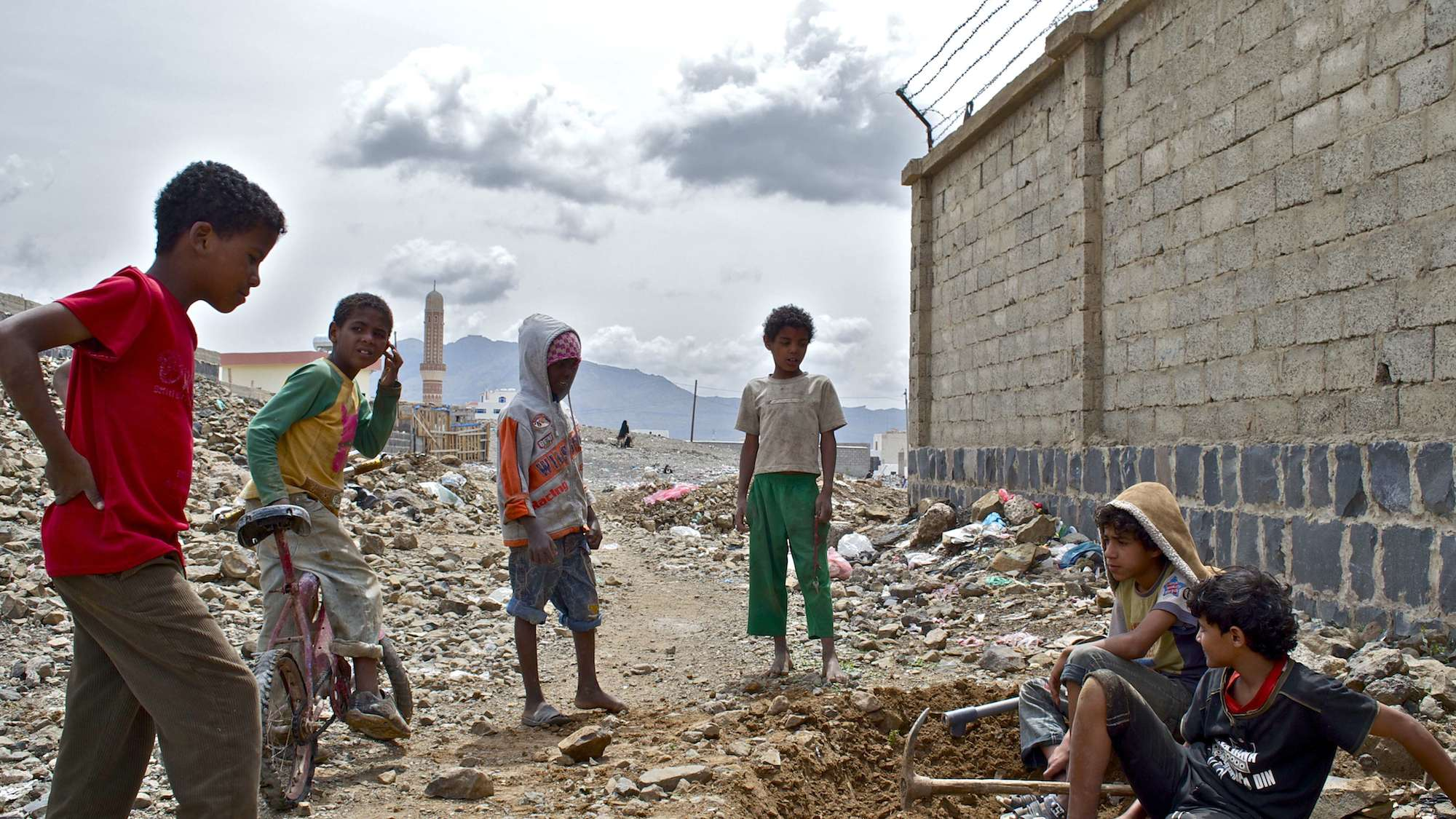 Yemeni children playing near the slum where they live in central Sana'a