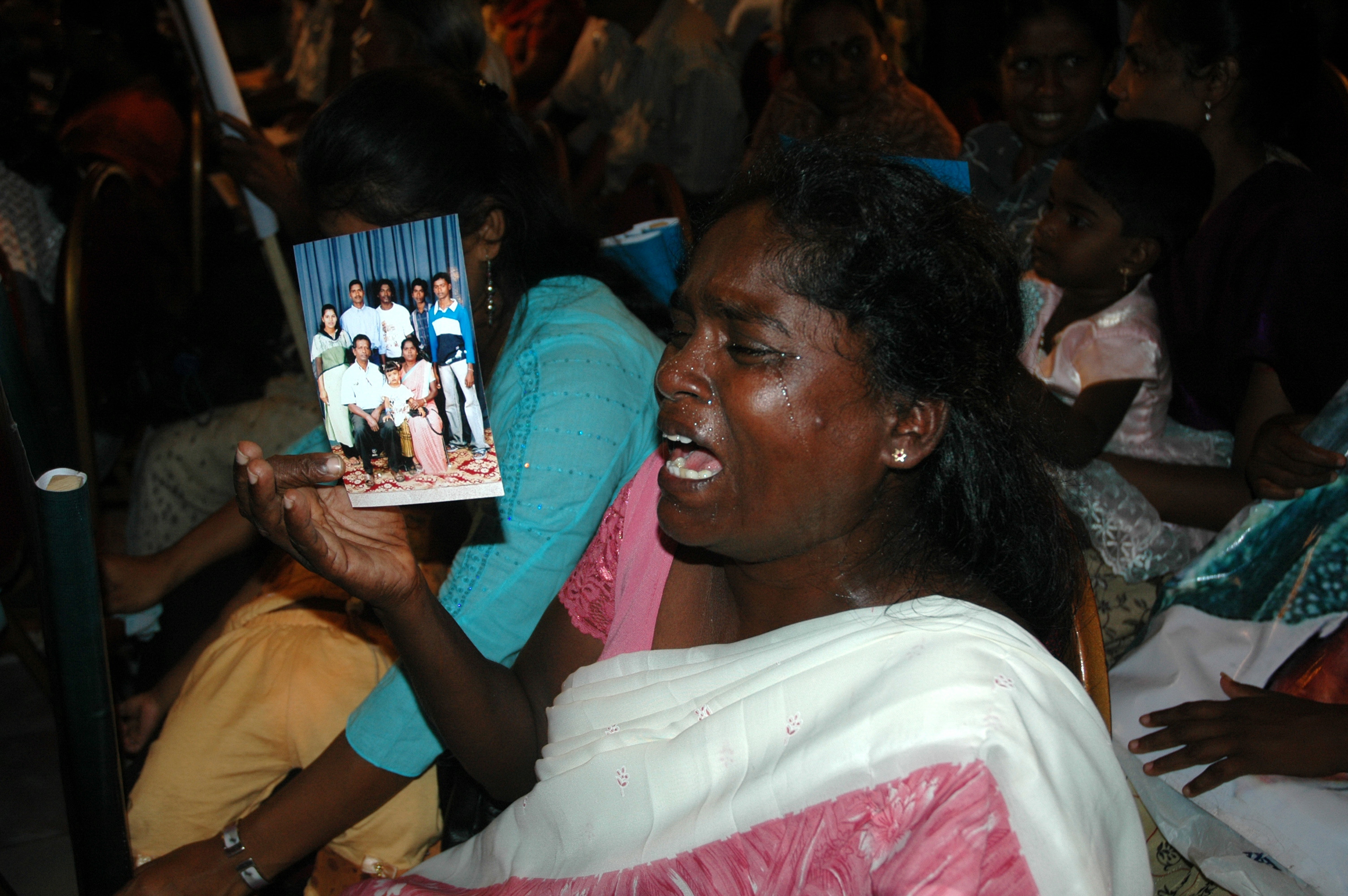 Family members of missing persons react during a meeting in the capital Colombo. There could be anywhere between 16,000 to 40,000 missing during the two and half decade war that ended in May 2009.