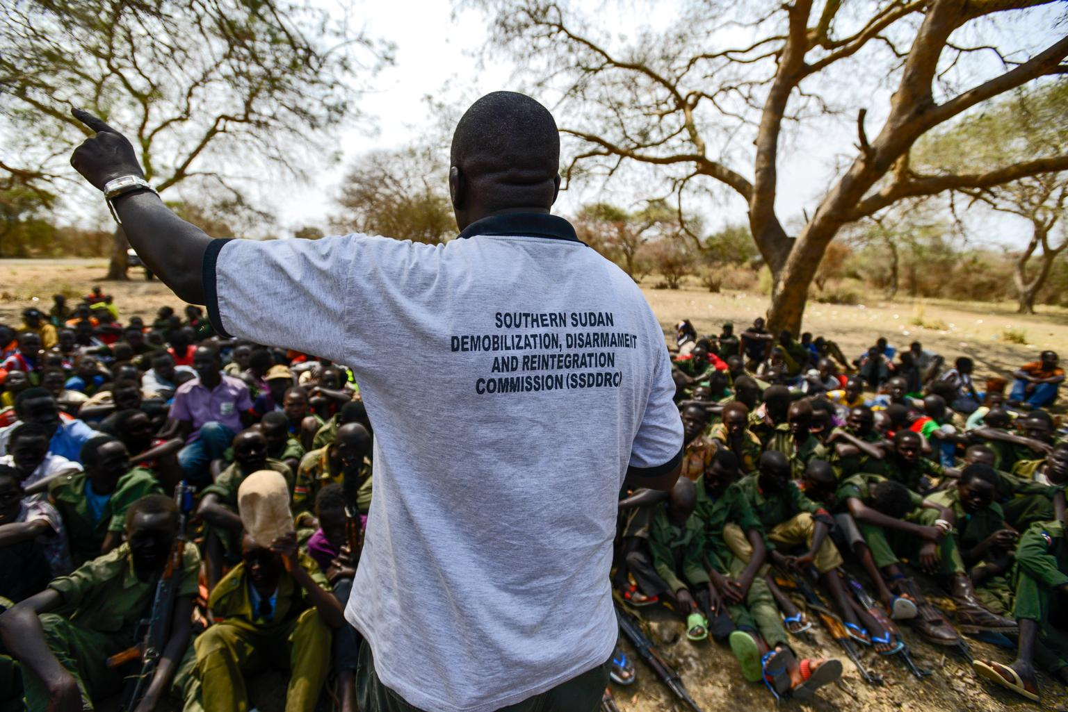 A worker from the South Sudan National Disarmament, Demobilization and Reintegration Commission addresses a group of children undergoing release from the SSDA Cobra Faction armed group, in Pibor, Jonglei State in January 2015.