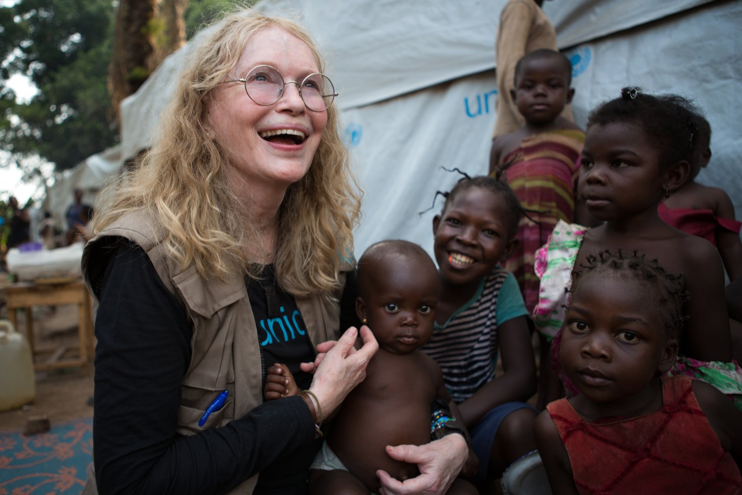 On 2 July 2015, UNICEF Goodwill Ambassador Mia Farrow greets internally displaced people (IDPs) in the Central African Republic (CAR), specifically  the St. Michel displacement site near the southern town of Boda in Lobaye Prefecture.