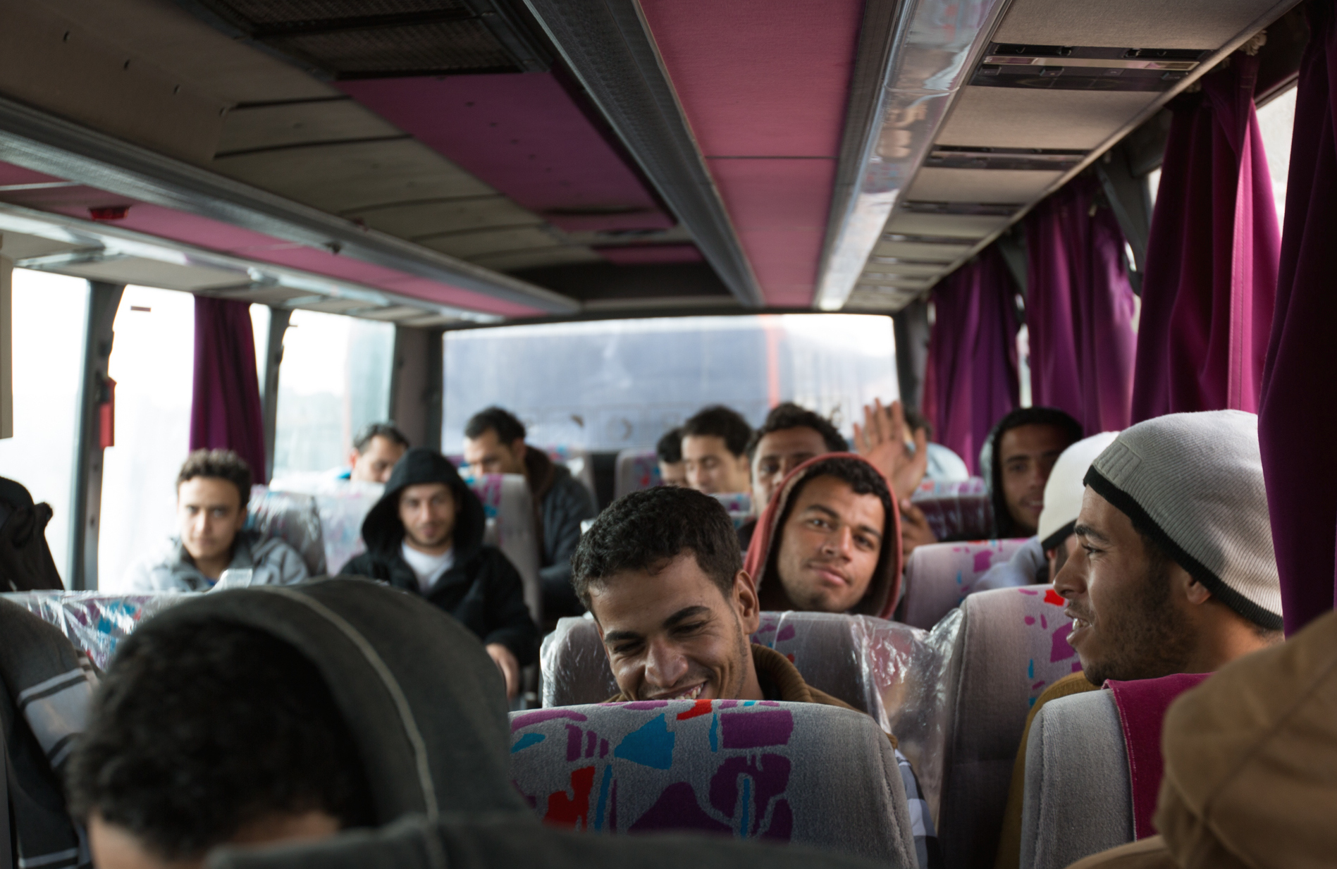 Egyptian workers held in a detention centre for illegal immigrants near Misrata on board a bus to Tunisia, from where they will be flown home.