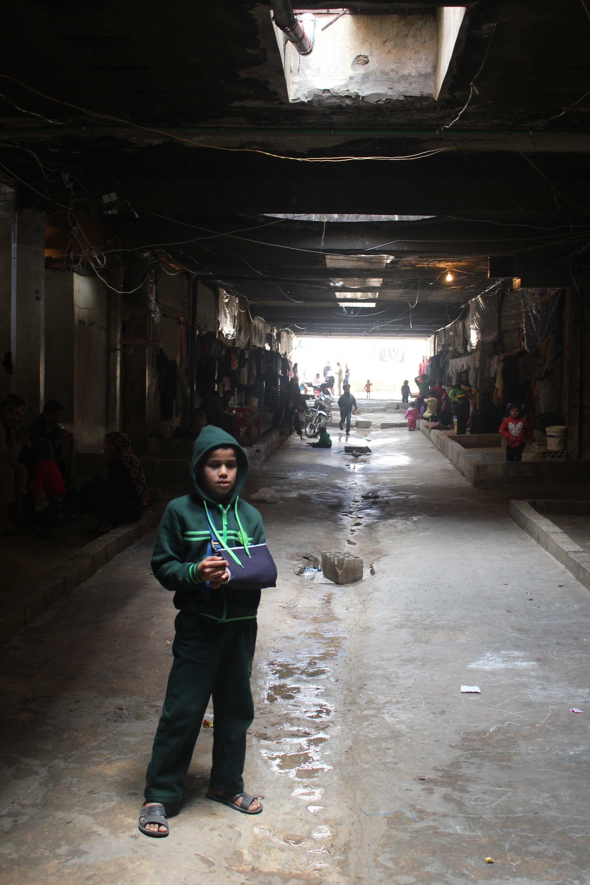 Around 850 Syrian refugees are living in an abandoned car park near the southern Lebanese city of Saida