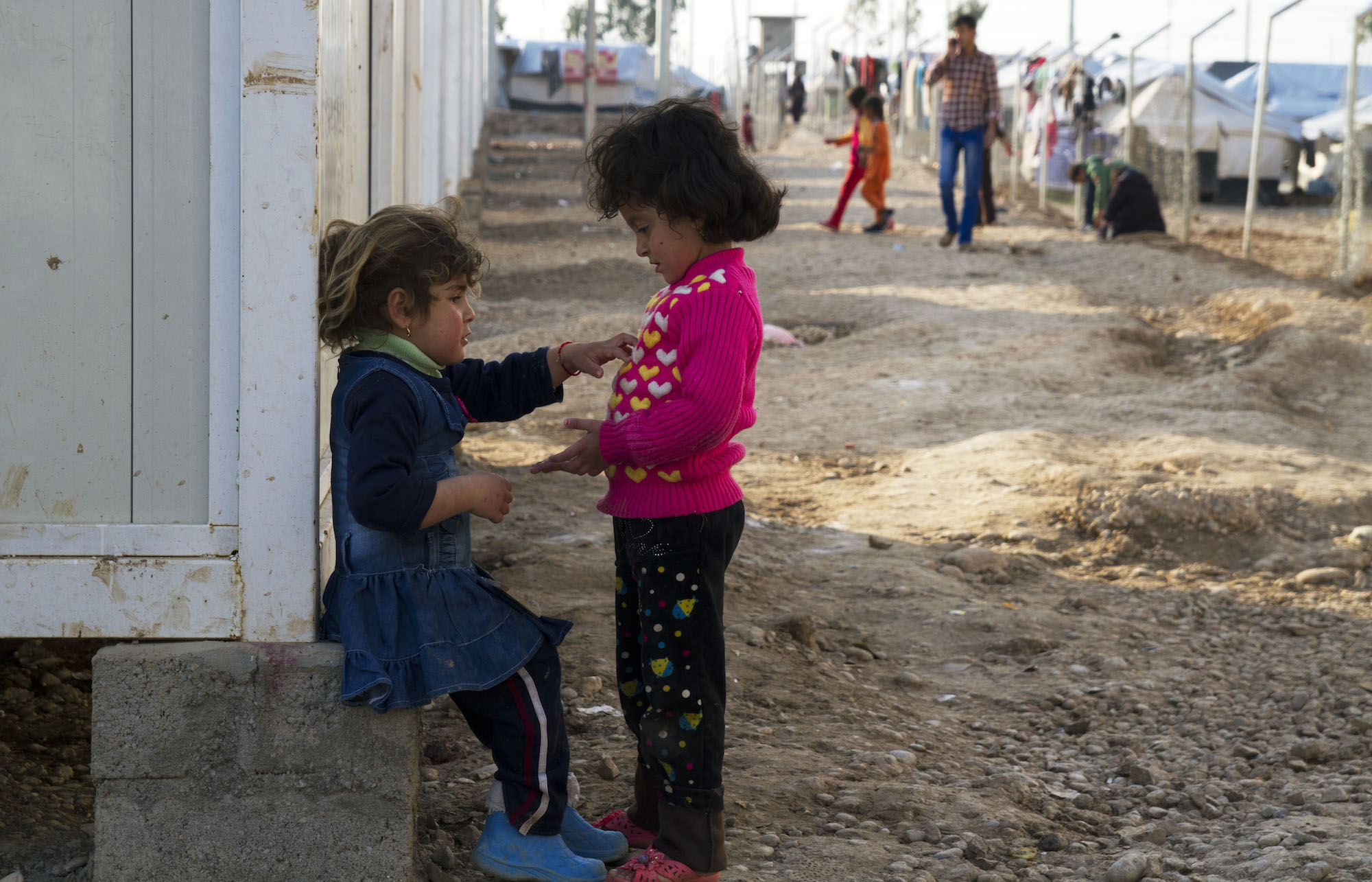 Two children play at the Baharka camp for displaced camp outside Erbil in Iraqi Kurdistan. Bathroom conditions at the camp have been described as deplorable. Toilets are filthy and showers are broken. Baharka, Erbil, Iraq