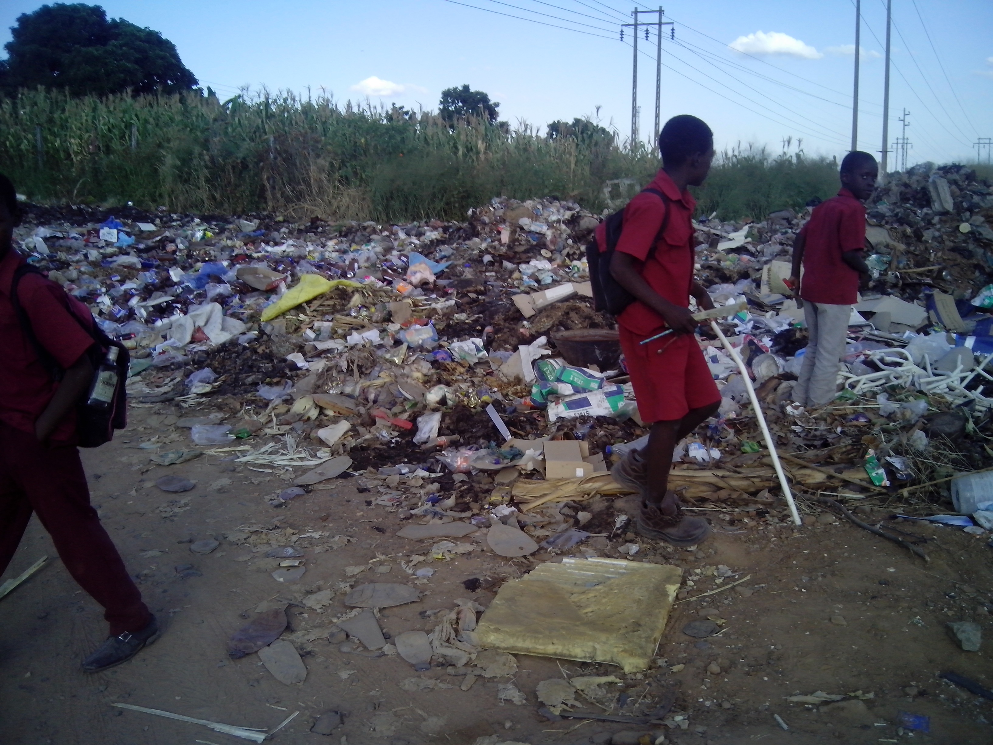 Children playing on dumpsite, Harare, 24 March 2015