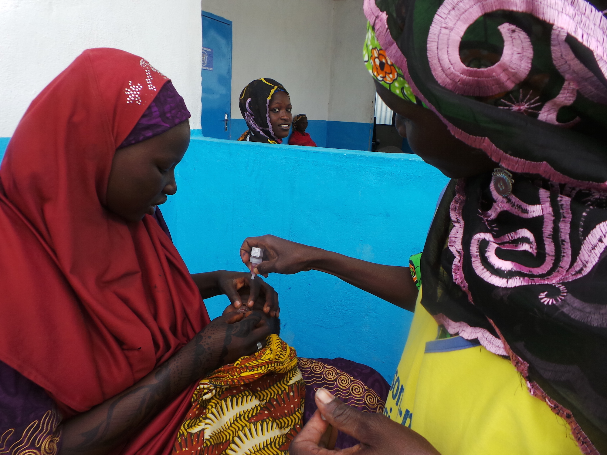 A child receives a polio vaccine at Minawao refugee camp in Cameroon's Far North Region in April 2015