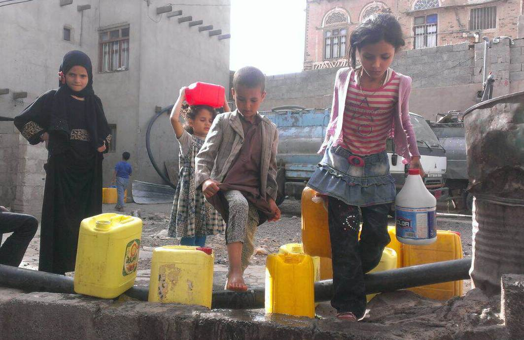 Yemeni children carry water from their local mosque in the capital Sana'a. A Saudi Arabian-led coalition began a bombing campaign against the Houthi rebels in Yemen three weeks ago