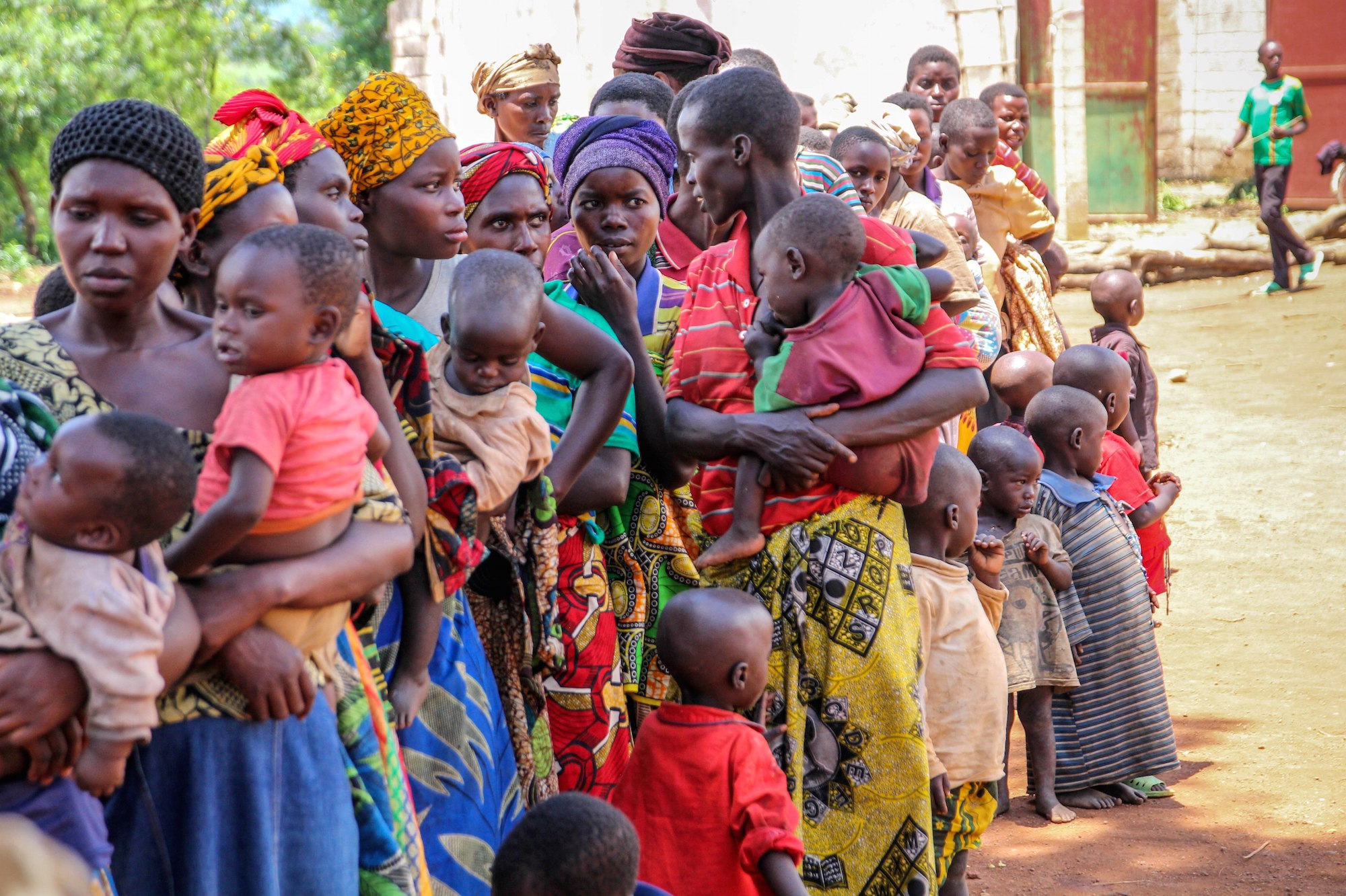 Mothers line up to register their children at a centre for Burundian refugees at Bugesera, Rwanda in April 2015