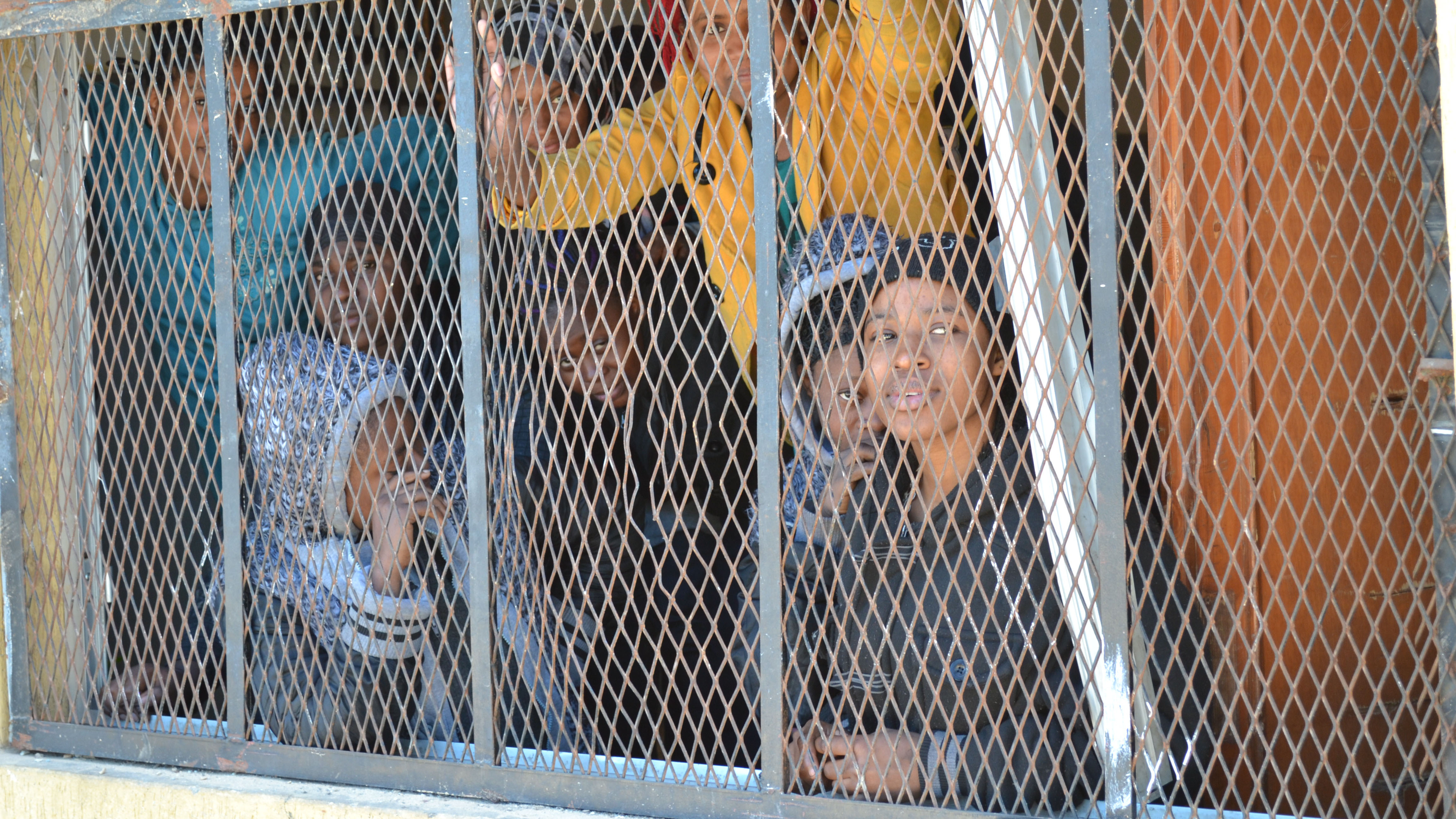 Women at a migrant detention centre in Surnam, Libya
