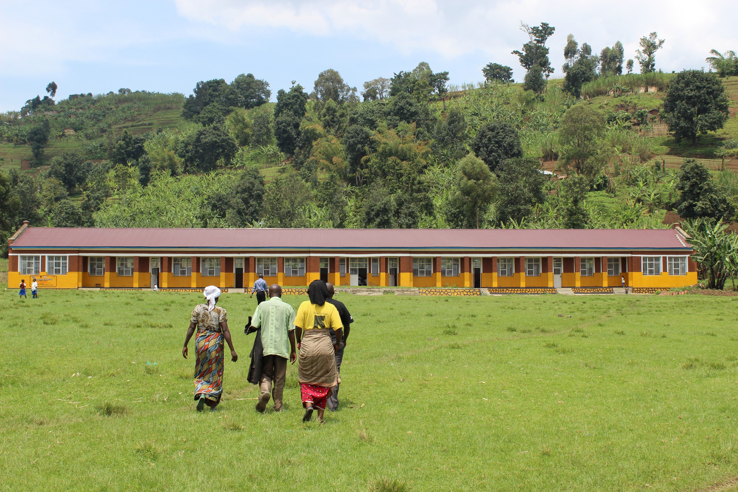 Parents and teachers in front of a school built by local communities with support from the IRC's Tuungane program funded by UK Aid in North Kivu, eastern Congo