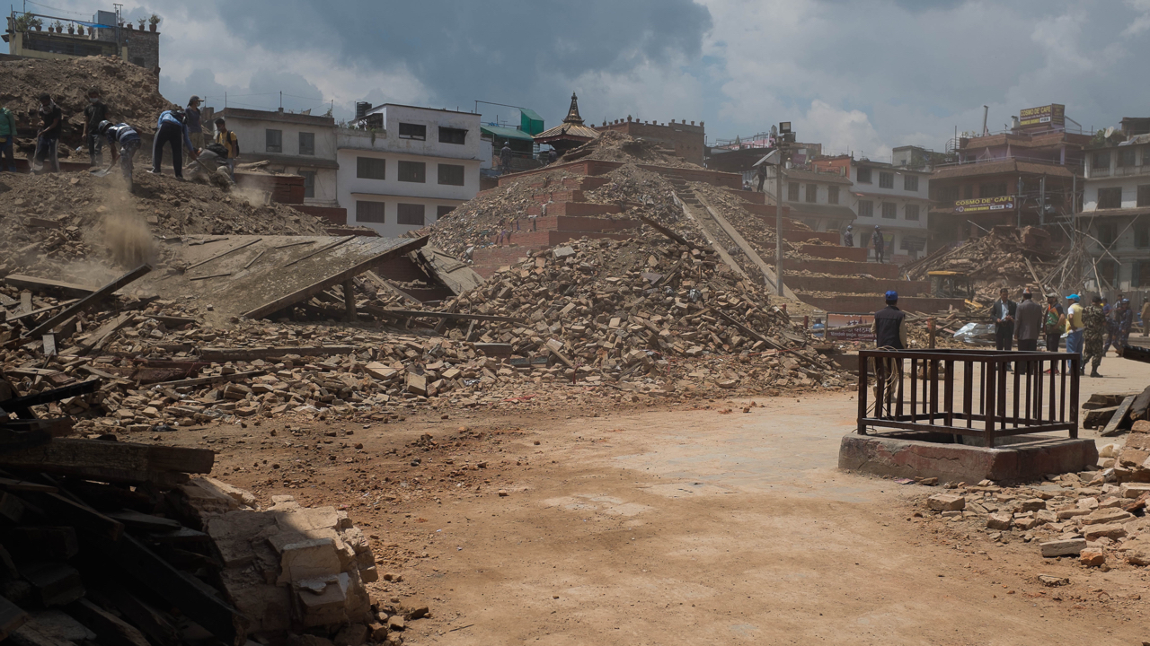 Rescue workers clear debris from collapsed monuments in search of survivors in Basantapur in Central Kathmandu on 27 April 2015 Nepal.