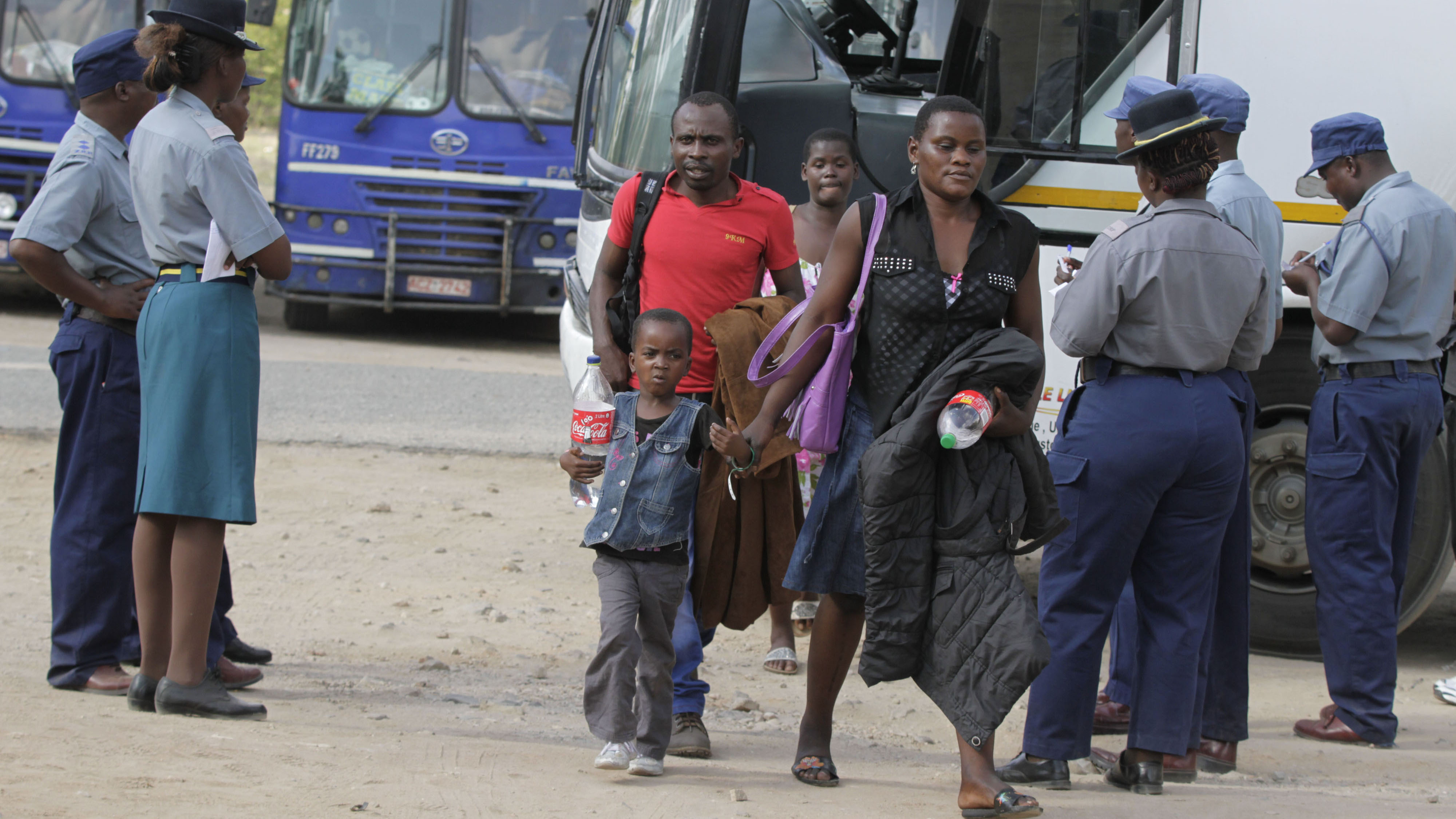 Zimbabweans fleeing xenophobic attacks in South Africa arrive at the border town of Beitbridge in government-provided transport