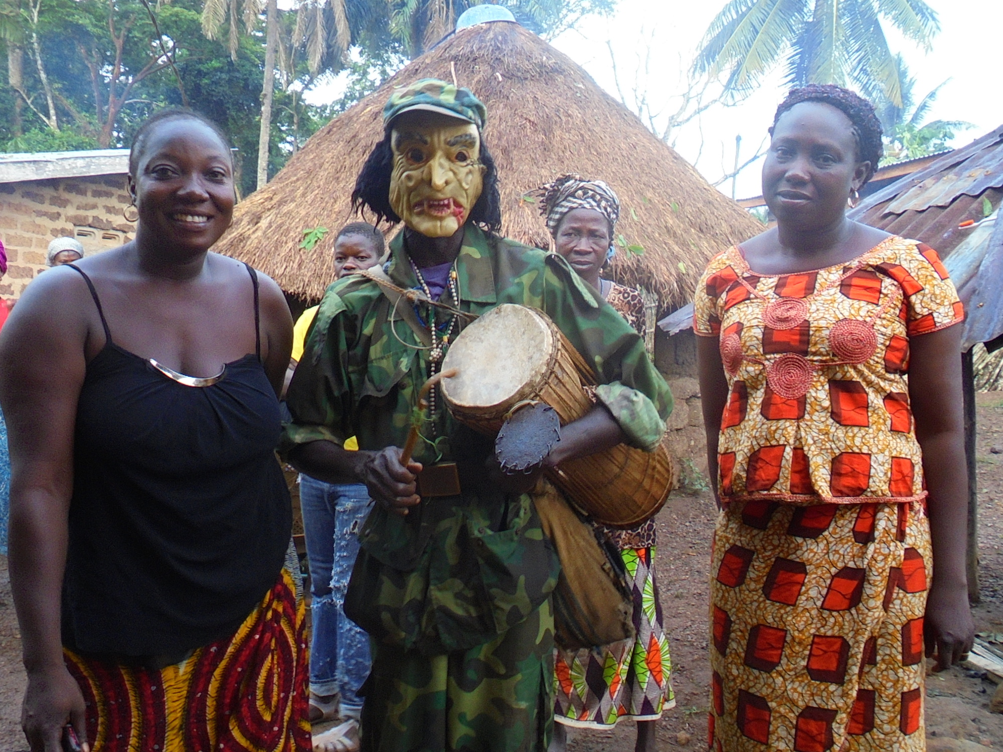 Drummers and dancers often come dressed in costume or masks as part of traditonal funeral rites in Guinea. Tamba Lamine Ouendeno was buried in April 2015, more than a year after his death from Ebola due to the clash between government restrictions on publ