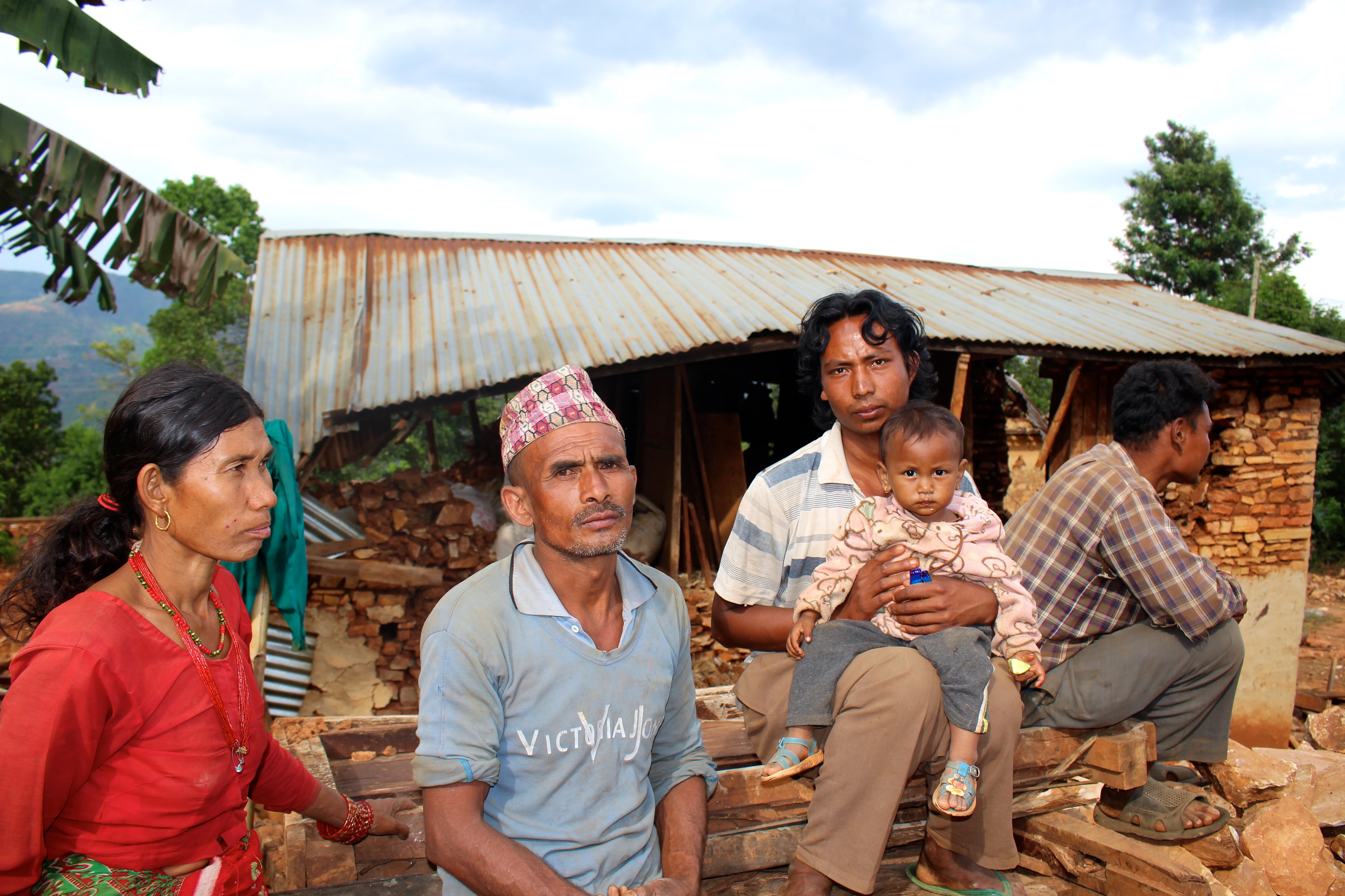 Bir Bahadur Rai and his family in front of their two houses that were completely destroyed in Banghar village after a major earthquake struck Nepal on 25 April 2015.