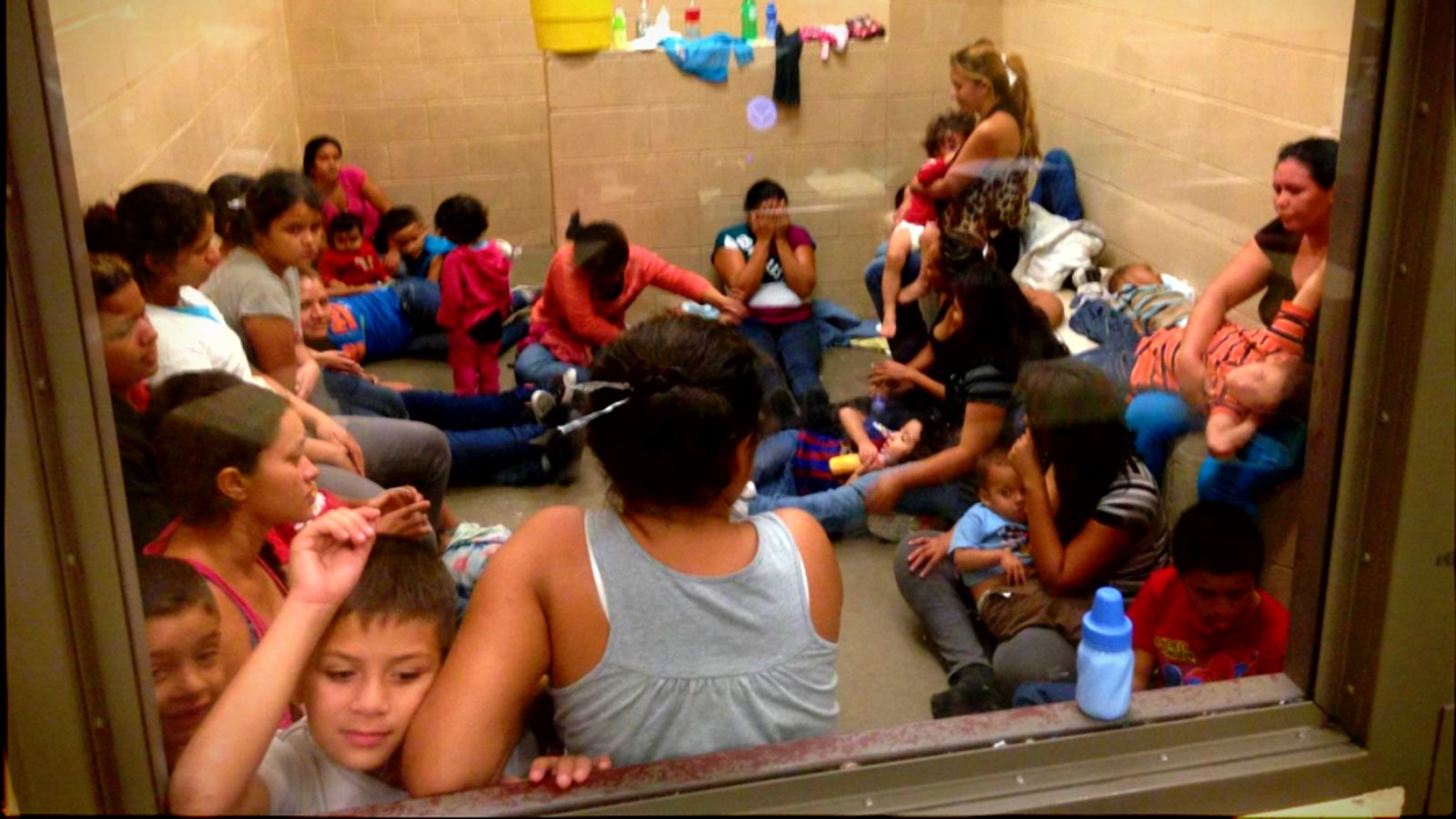 Migrants, among them many women and children, detained at a border patrol station in Texas, United States