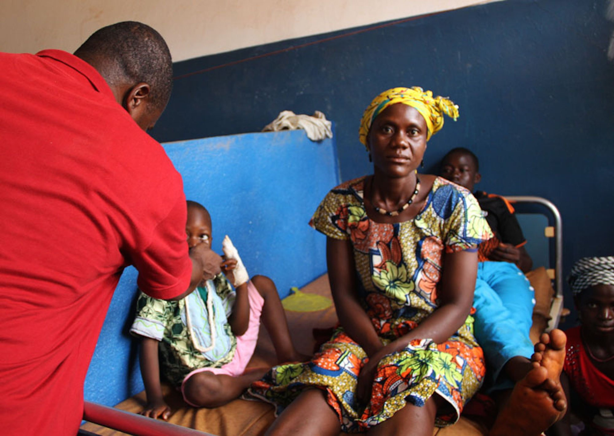 Doctor Kalissa N'Fansoumane (in red) sees patients at a hospital in Gueckedou in April 2015