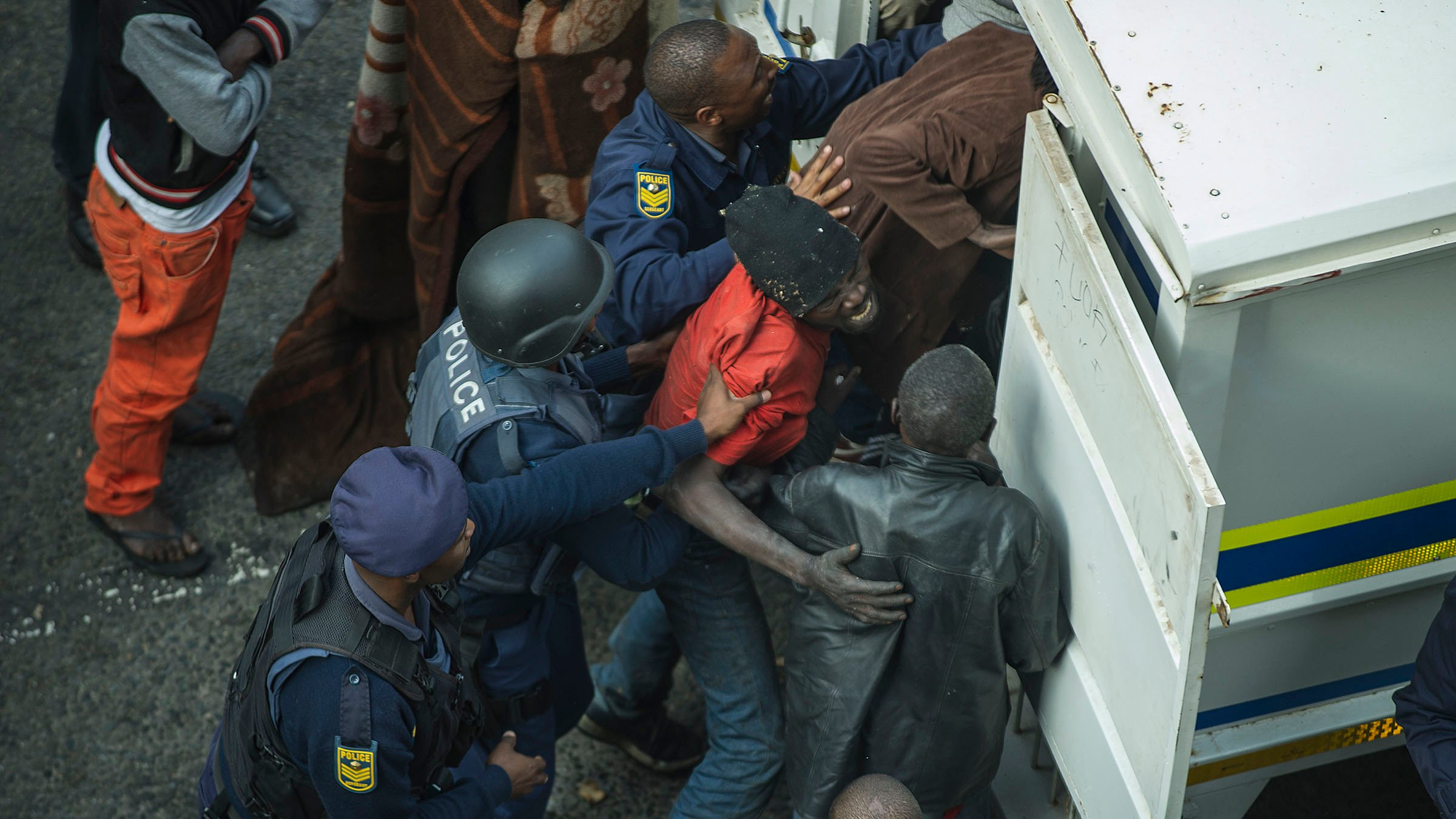 South African police officers raided buildings in Johannesburg's city centre in the early hours of 8 May 2015 and arrested more than 300 foreign nationals.