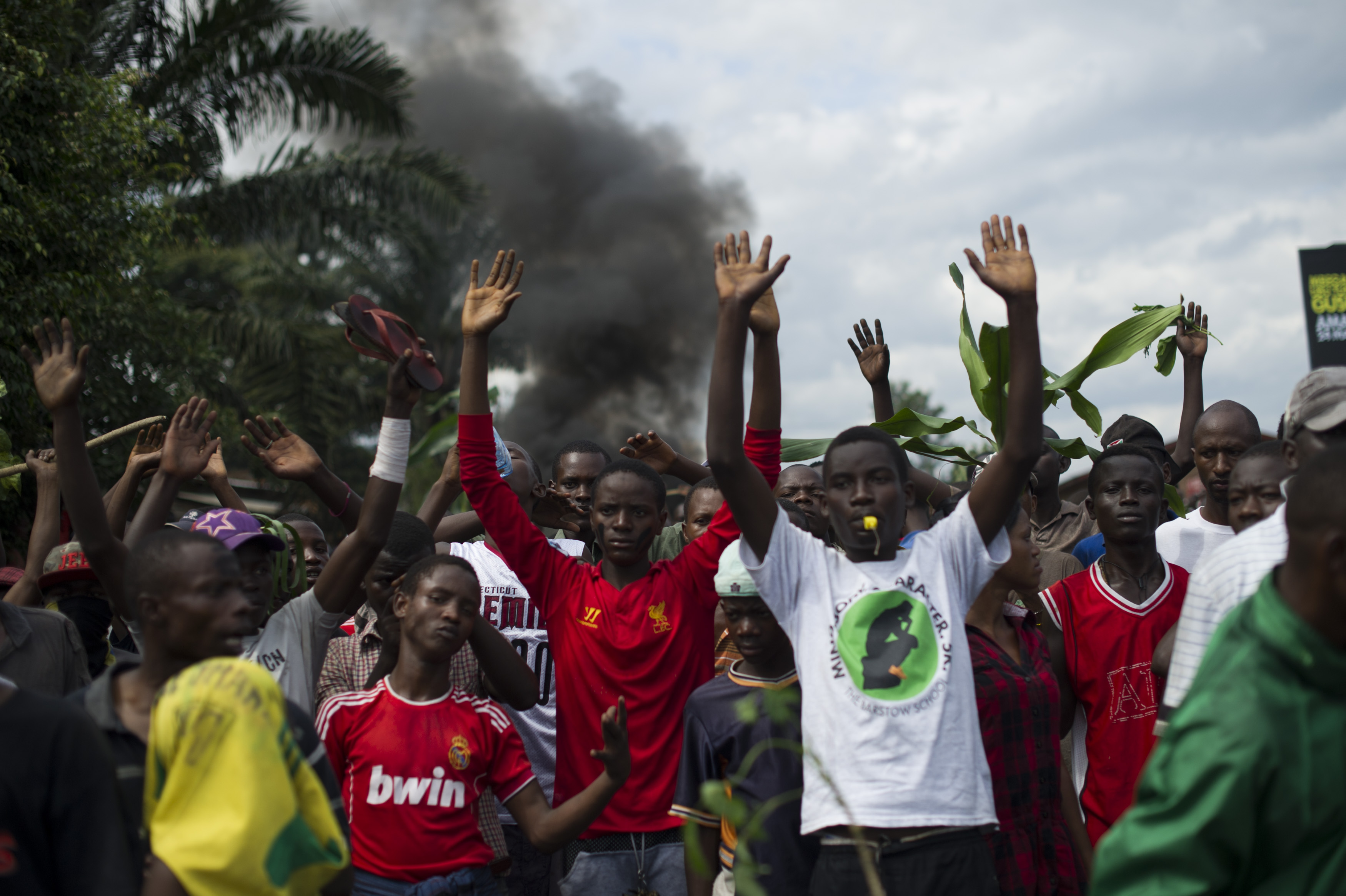 Protestors raise their hands in front of police in the Musaga neighbourhood of Bujumbura, Burundi, on May 4, 2015.