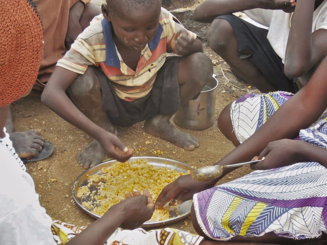 A displaced family in Cameroon's northern Mayo-Sava department taking a meal of cooked maize
