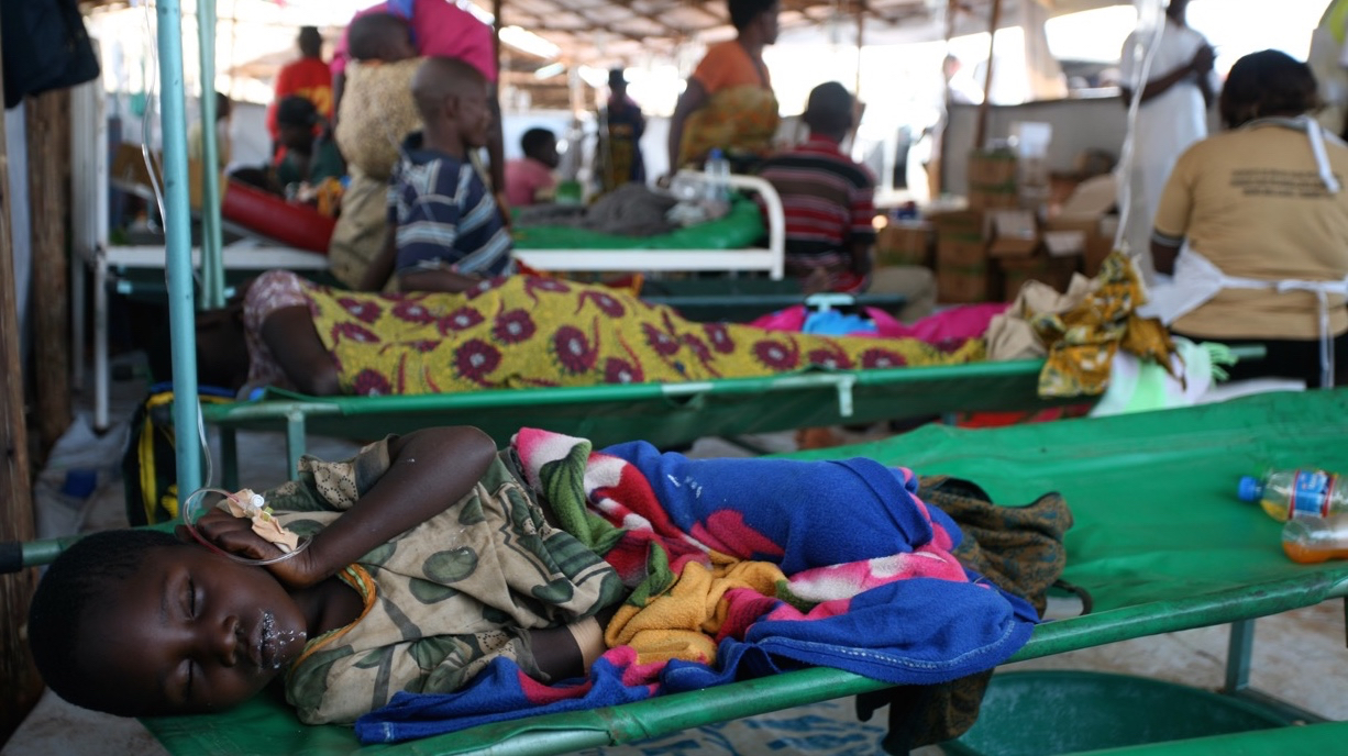 A young Burundian refugee suffering from diarrhoea with suspected cholera lies in the health clinic at Lake Tanganyika Stadium in Kigoma, Tanzania. Tens of thousands of Burundians have fled across borders to neighbouring countries amid growing political t