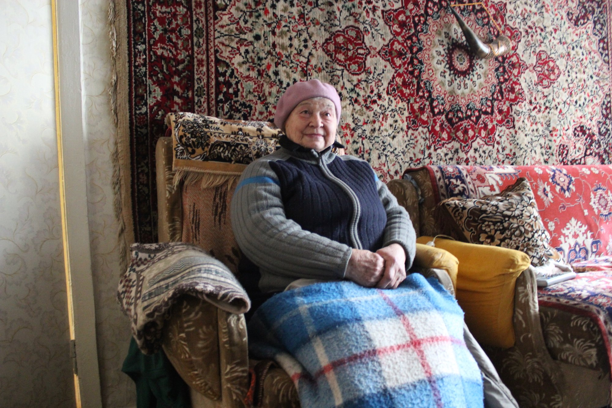 Anna Reshedko, 78, struggles to keep warm in March 2015 in her flat in the rebel-held Ukrainian town of Pervomaisk close to the frontline of a 13-month conflict that has left thousands cut off from aid
