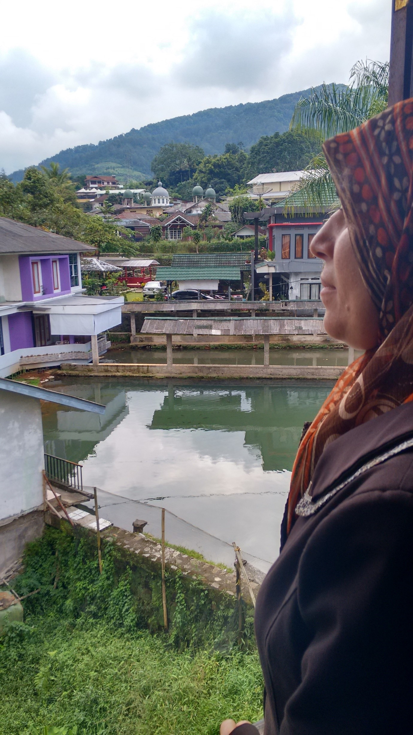 Maysoon looks out over Ciasura in Indonesia where she and her family have spent the last nine months waiting for UNHCR to process their asylum applications