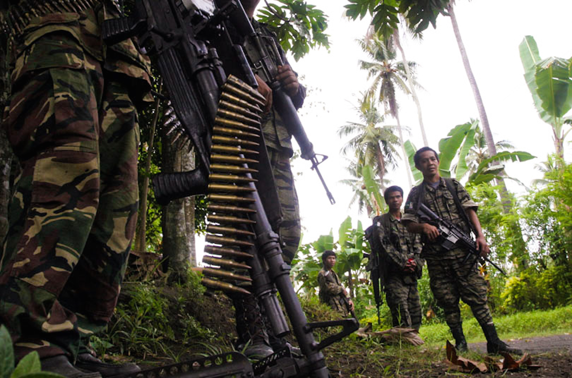 Camp Darapanan, Mindanao - Armed MILF guards patrol the grounds of a rebel camp in the southern Philippines