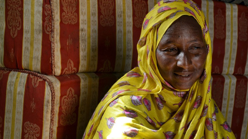 Whabi, a former female slave from the Haratine ethnic group, now makes a life for herself dying and sewing cloth veils.