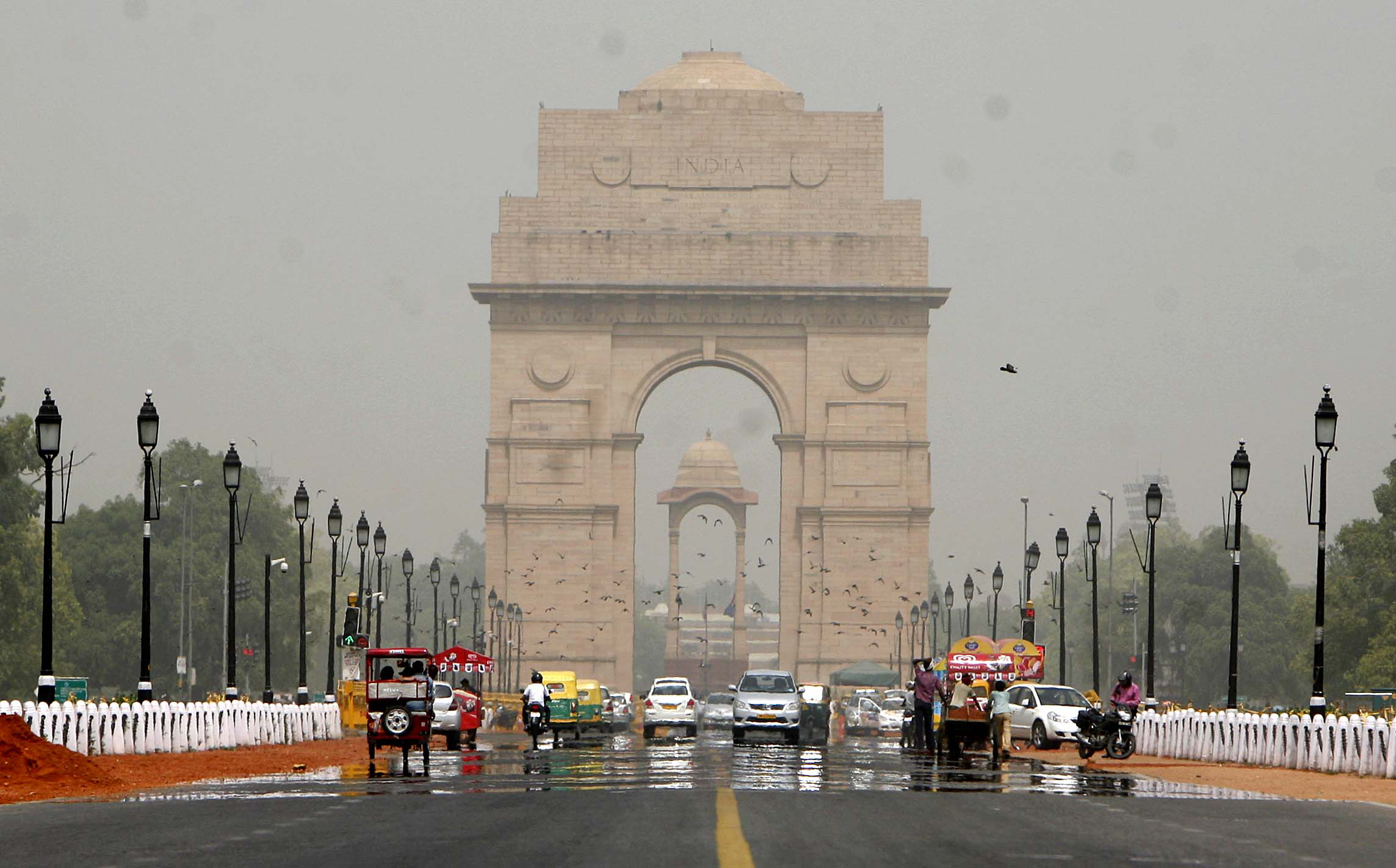 A mirage shimmers over Rajpath leading to India Gate on a hot day in Delhi