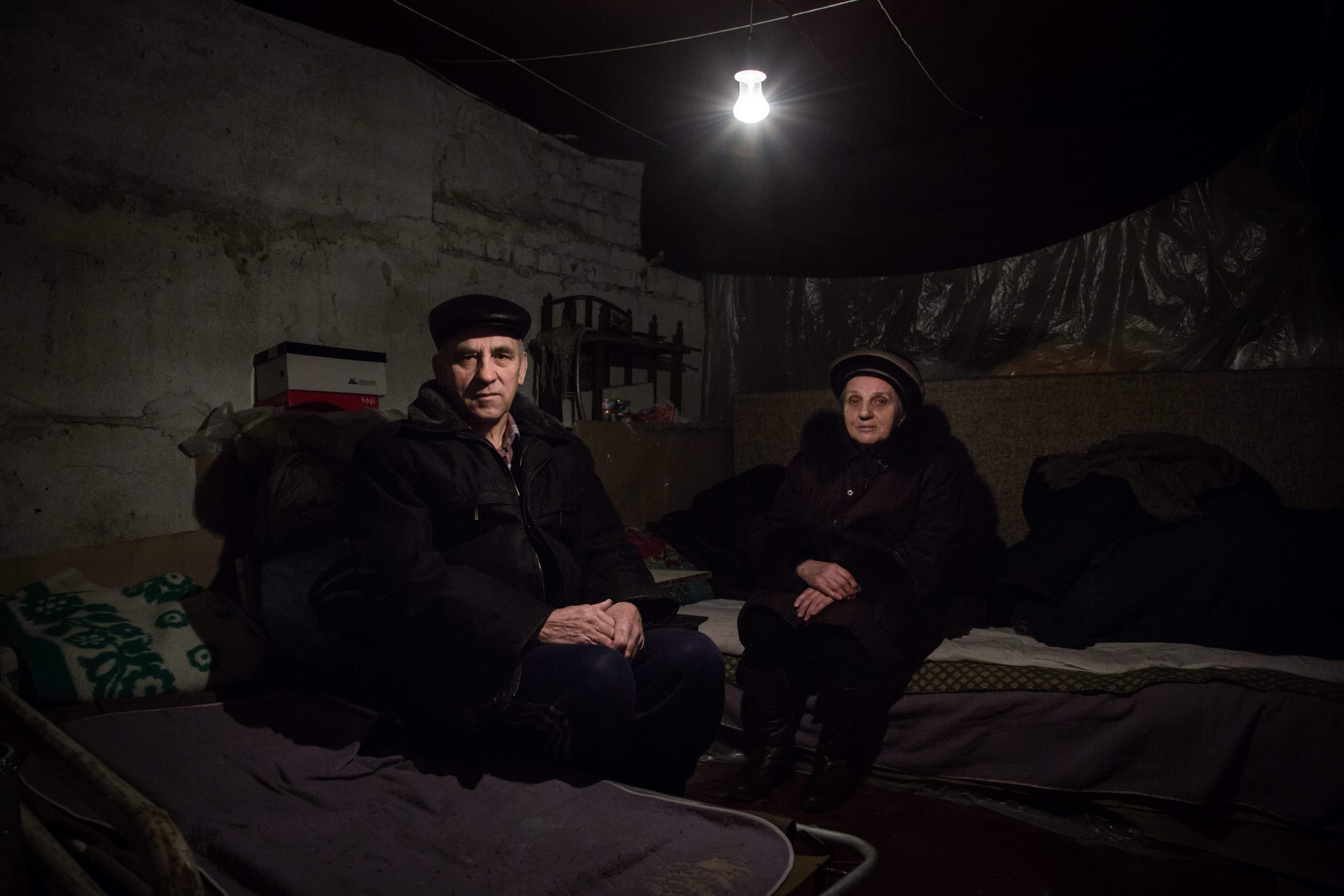 Aleksey and Anna, both 68, shelter in the basement of their apartment block in the Kievsky district of Donetsk, Ukraine.