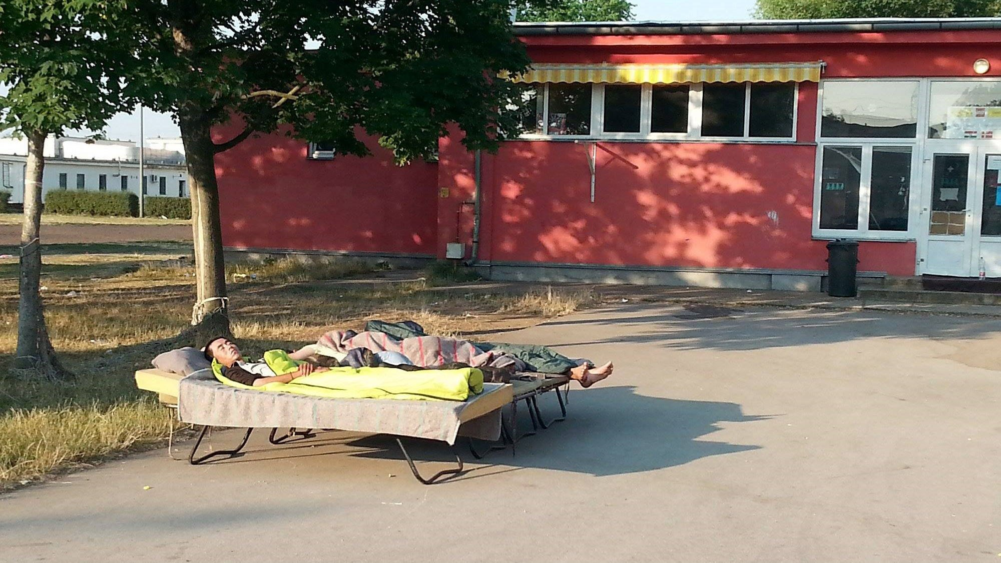 New arrivals at the Debrecen centre for asylum seekers in Hungary have to sleep outside because of overcrowding. The centre has an official capacity of 1,000 but currently has about 2,000 people staying there.