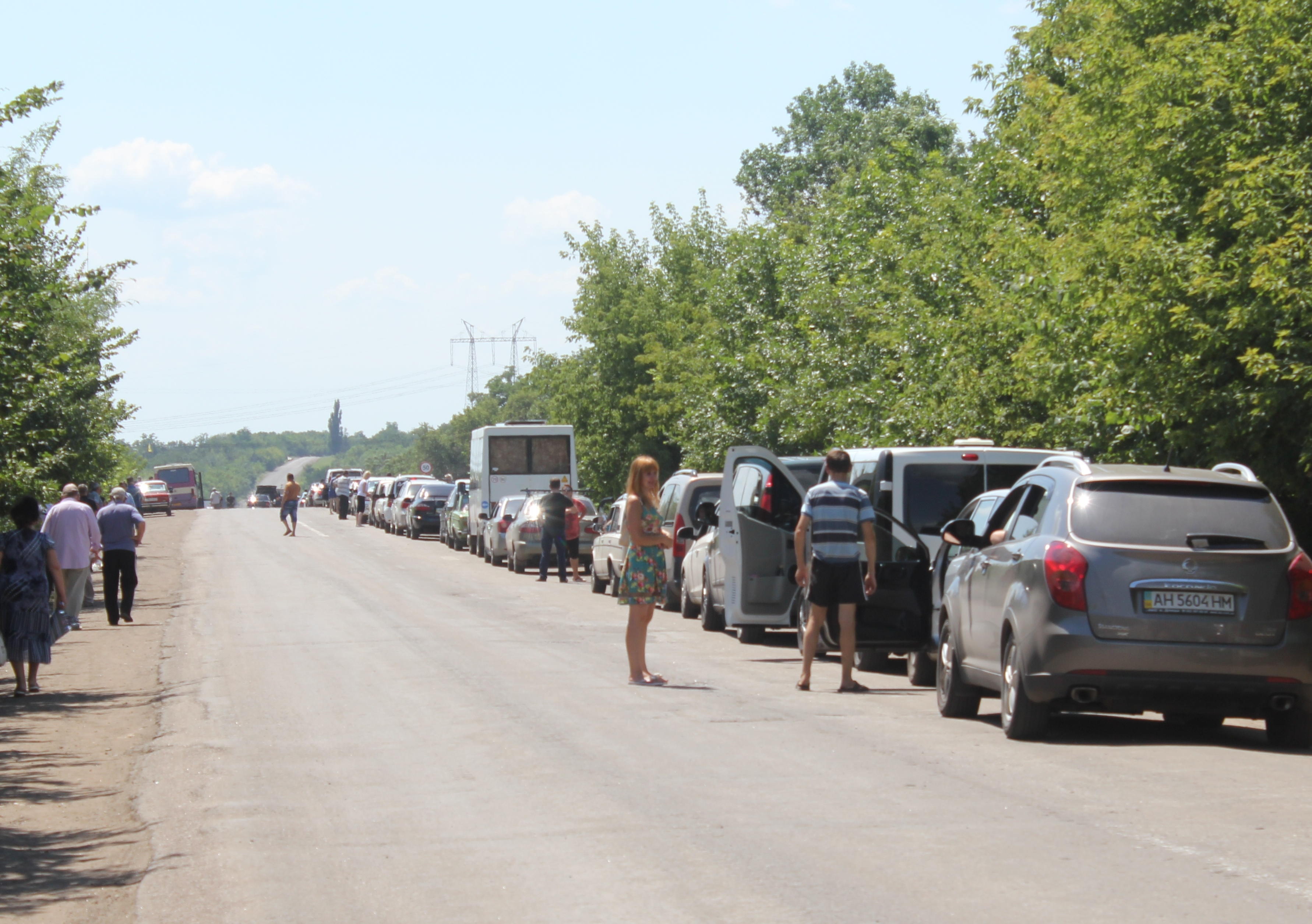 Cars line up at the government checkpoint near Artemivsk town in eastern Ukraine. New government orders have made it harder for people and goods to cross from rebel-held to government-held areas.