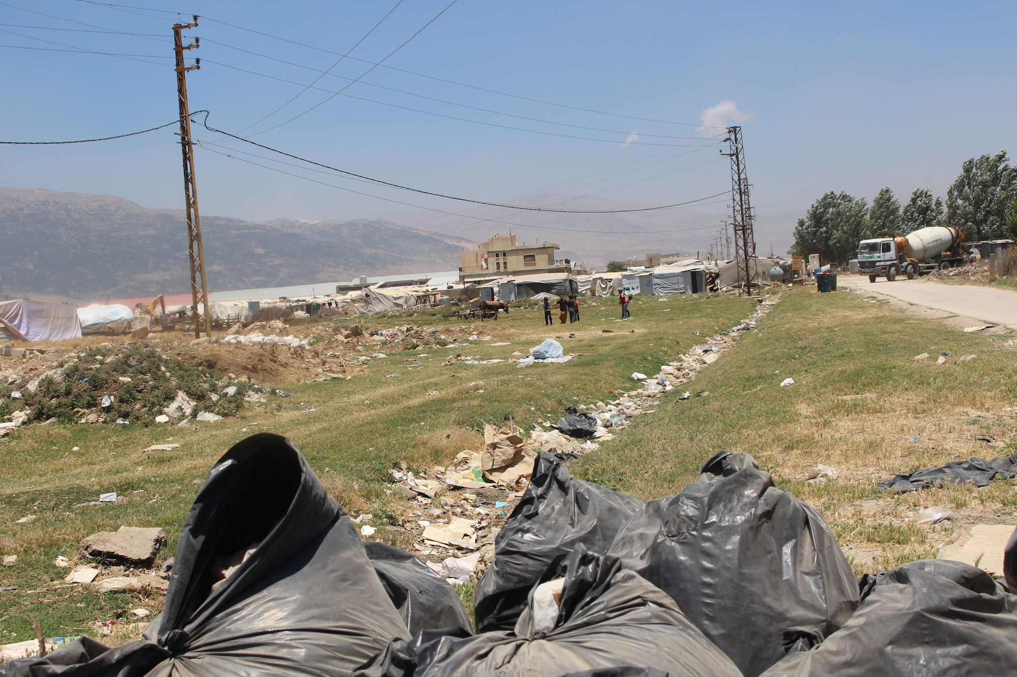 Syrian refugees in the Bekaa Valley, Lebanon. They have dumped their rubbish in local areas, leading to issues around clean water.