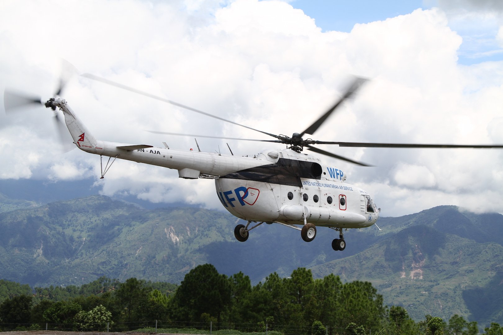 A United Nations helicopter takes off from Chautara, in Nepal's Sindhupalchok District, to transport roofing material to a remote village to rebuild homes damaged in the earthquakes of April and May 2015.