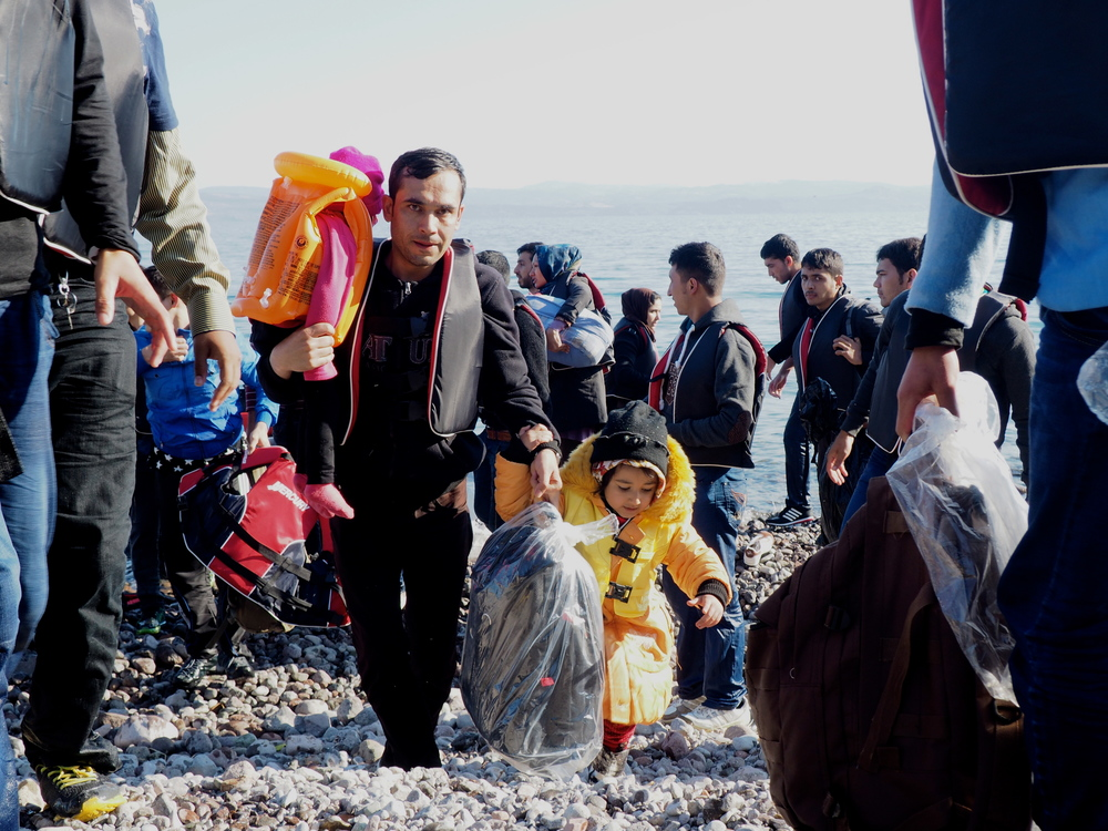 A migrant family comes ashore at Sklala Sykaminias. The majority of arrivals to Greece are Syrians, followed by Afghans.
