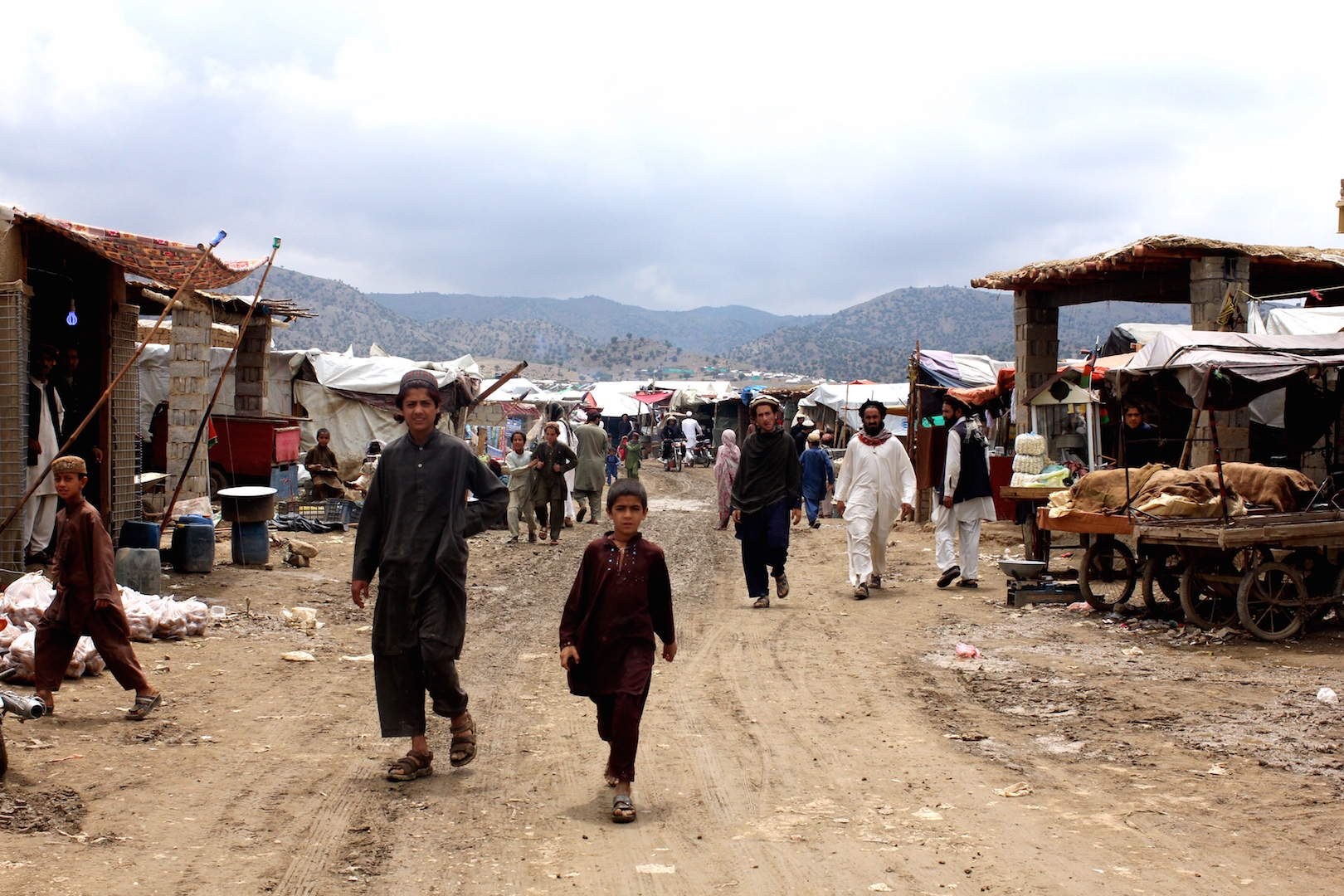 The growing permanence of the Golan refugee camp in Afghanistan's Khost province can be seen in the bazaar that has sprung up in the camp, seen here on 12 May 2015