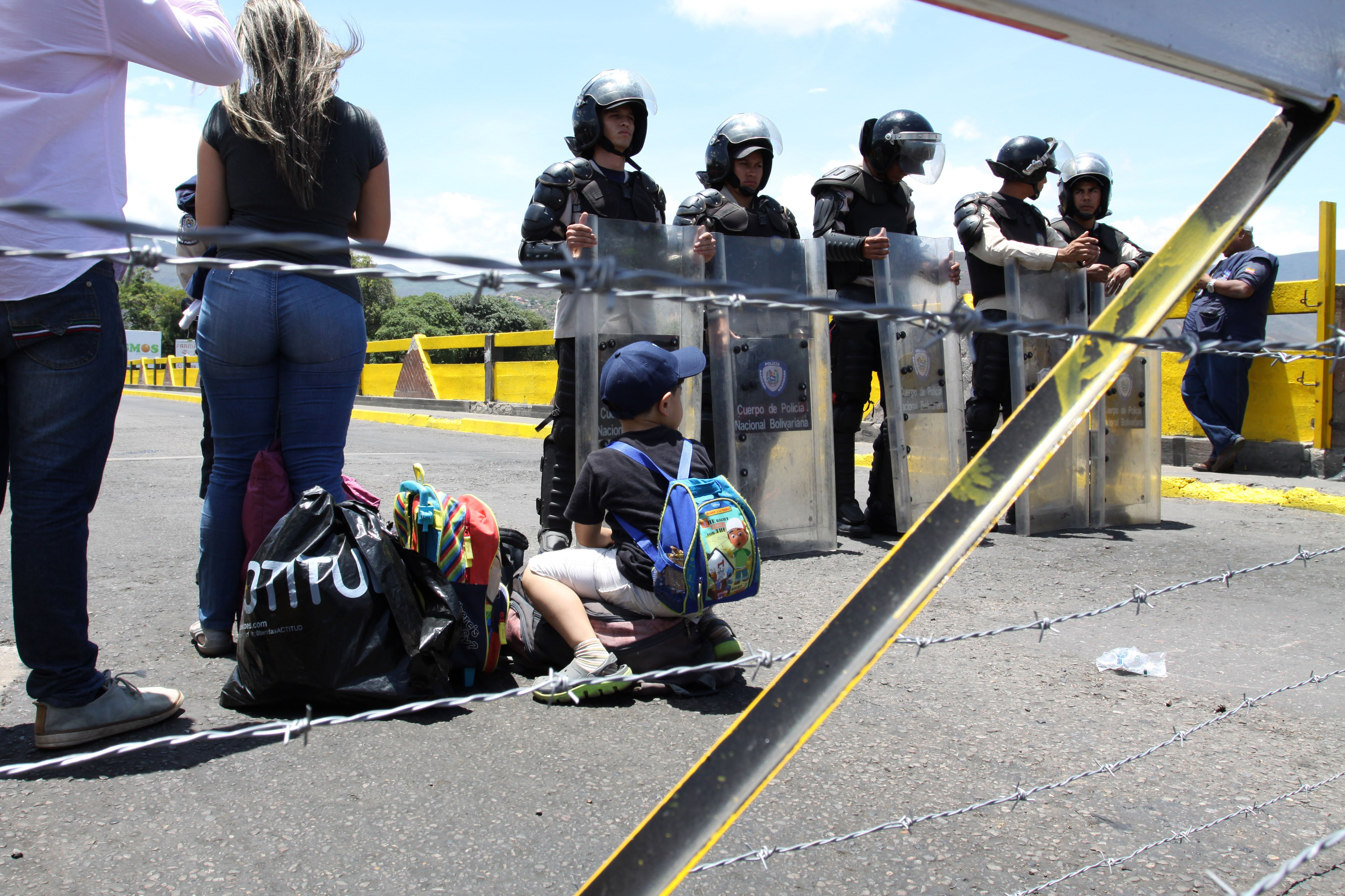 Police line up to block crossings of the Simón Bolívar Bridge at Venezuela's border with Colombia.