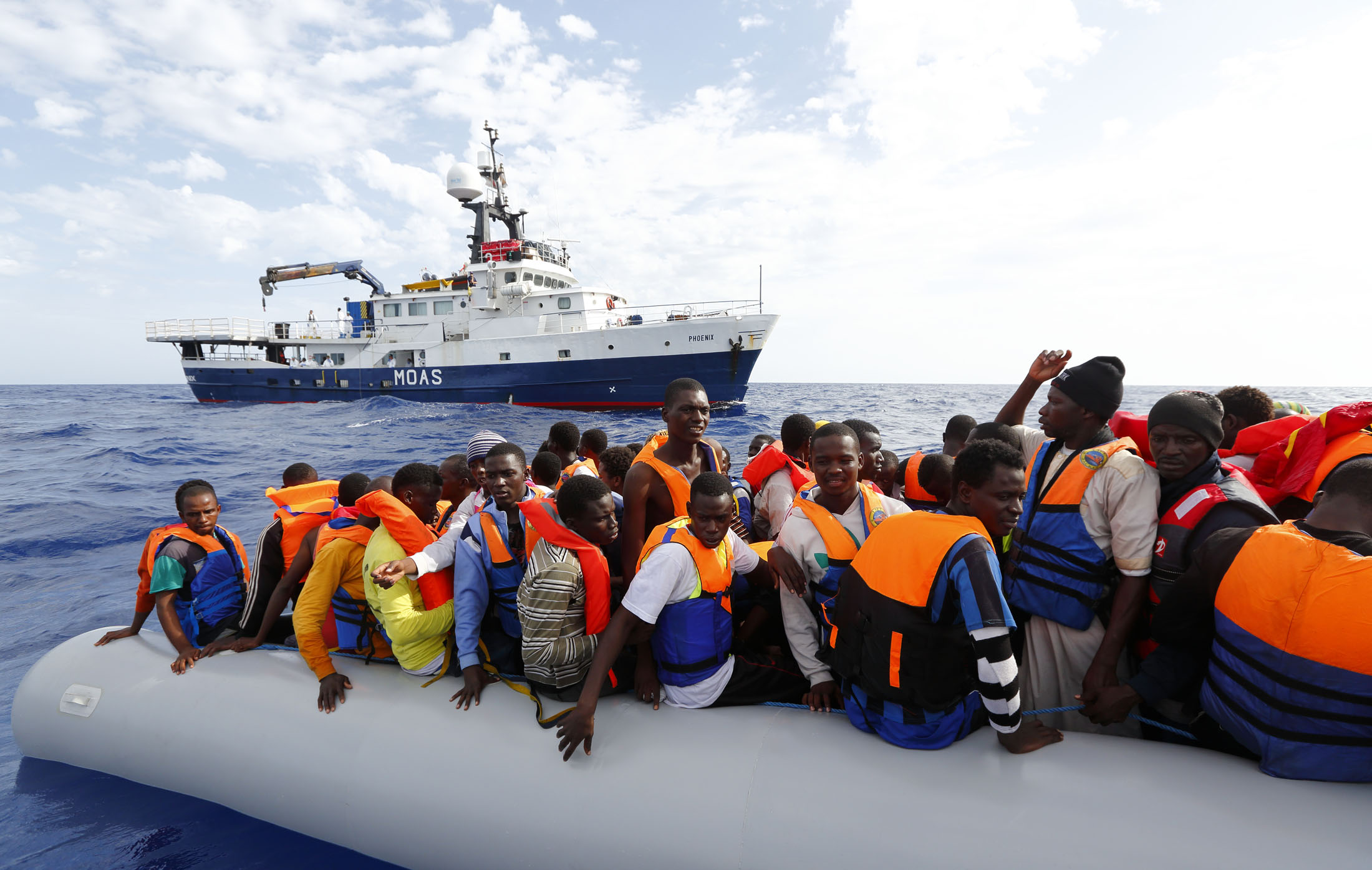 A ship run by the Migrant Offshore Aid Station rescues people attempting to enter Europe by boat on the Mediterranean Sea in 2014