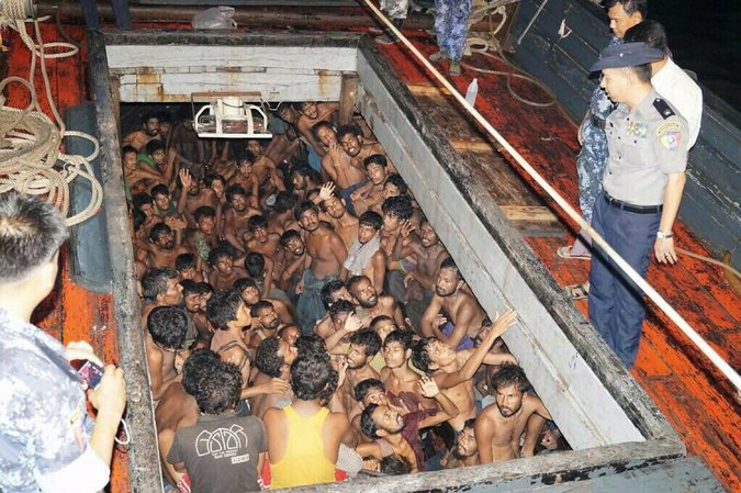Myanmar authorities on a boat that was transporting migrants and refugees and was found by the Myanmar navy in May 2015 and towed to shore