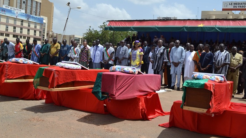 Authorities in Burkina Faso pay their respects to the 14 civilians who were killed by security forces during the days of violence following the 16 September coup.