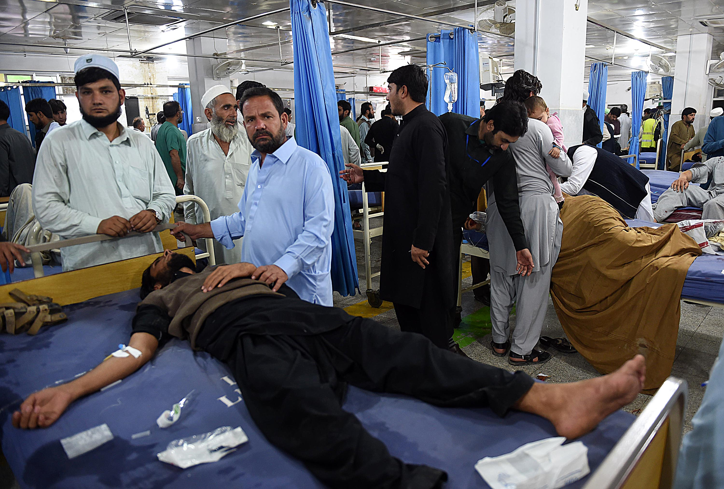 Earthquake victims at a hospital in Peshawar, Pakistan