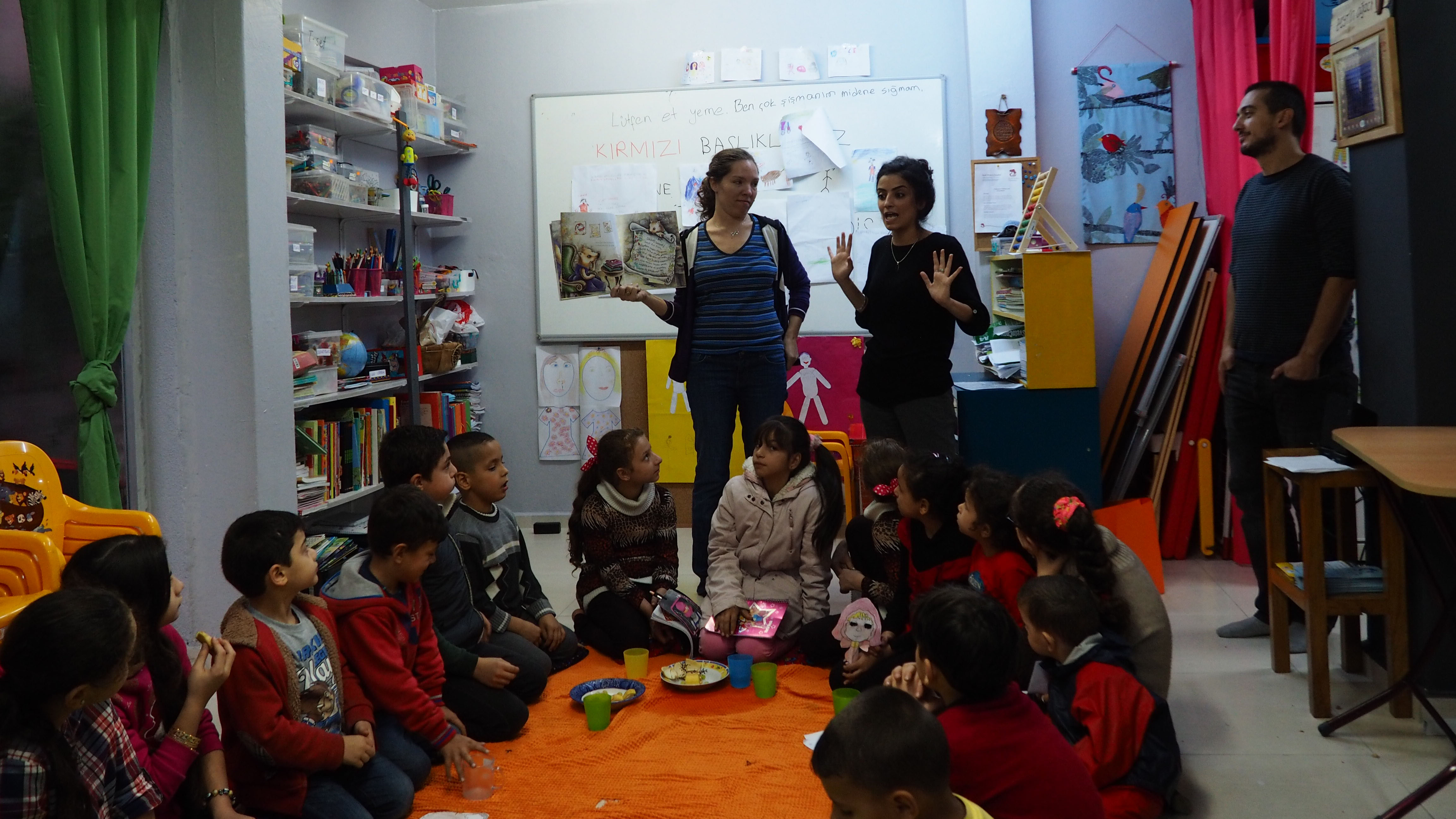 Teachers with Small Project Istanbul tell a popular Syrian fairy tale to a class of Syrian children in both Arabic and Turkish