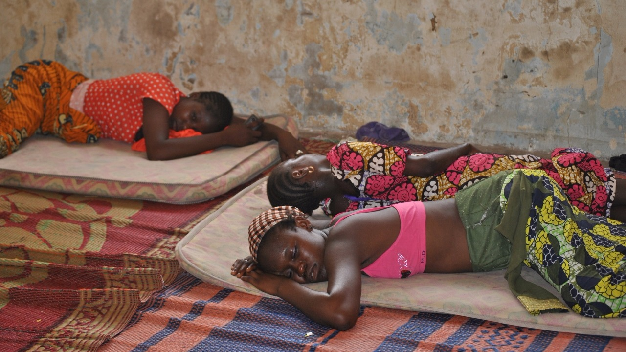 Displaced girls sleep in the floor in a rented house in Yola. IDPs share overcrowded houses and are often left to fend for themselves.
