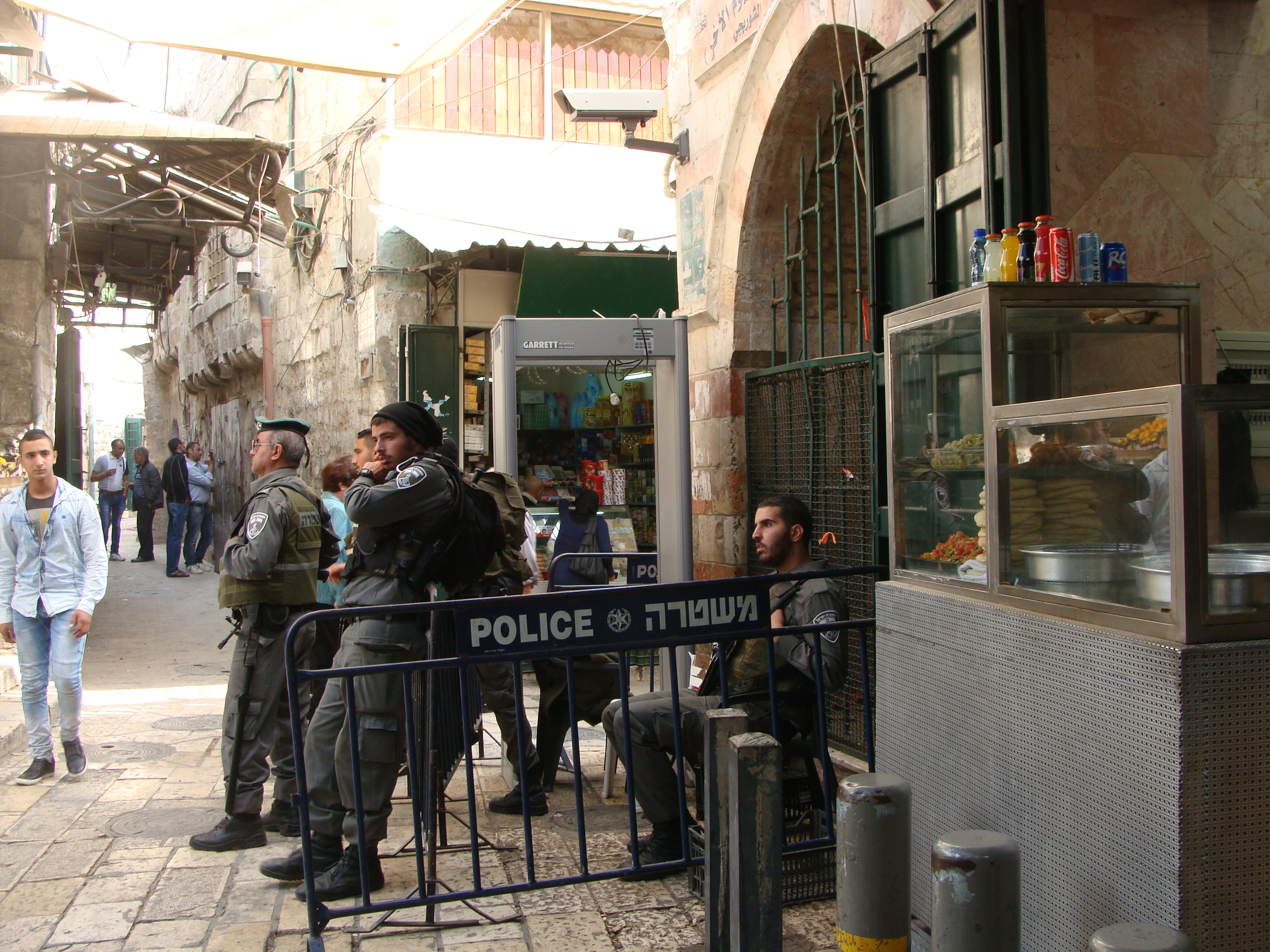 Israeli forces and a newly installed metal detector on the corner of Al Wad Street, in Jerusalem's Old City.