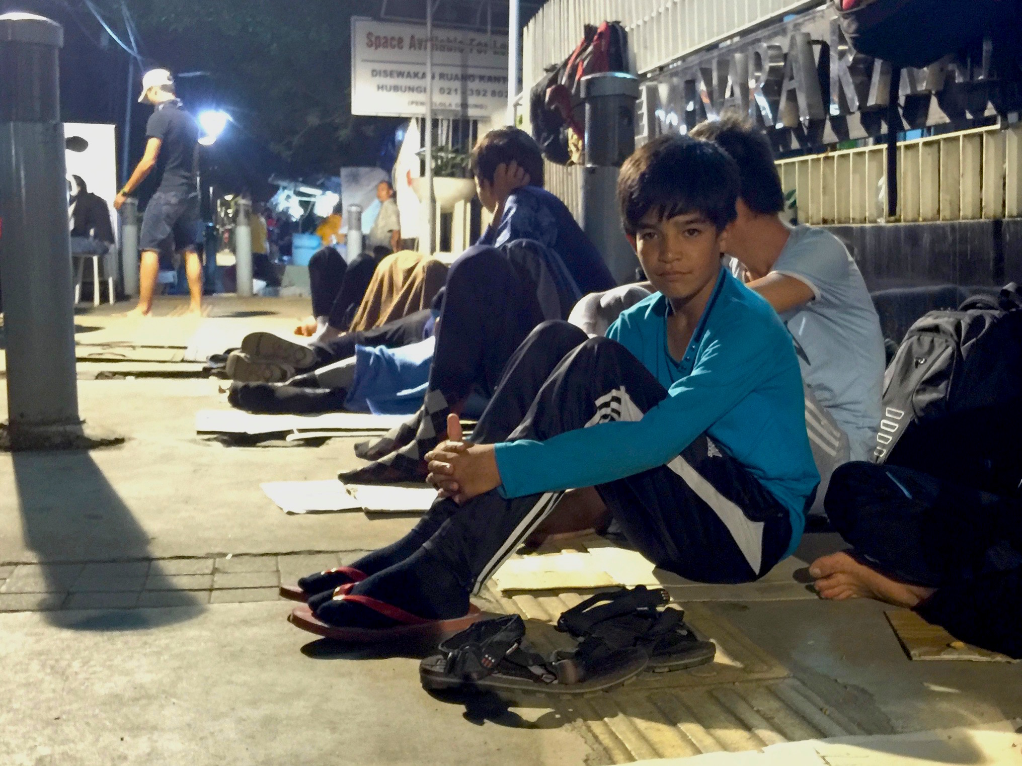 Ethnic Hazara refugees from Afghanistan and Pakistan camp outside the UNHCR office in Jakarta, Indonesia, in December 2015