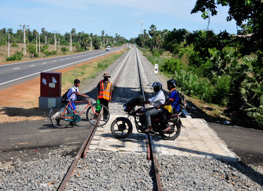People near the northern Sri Lanka village of Pallai cross a railway line that was under construction in September 2014