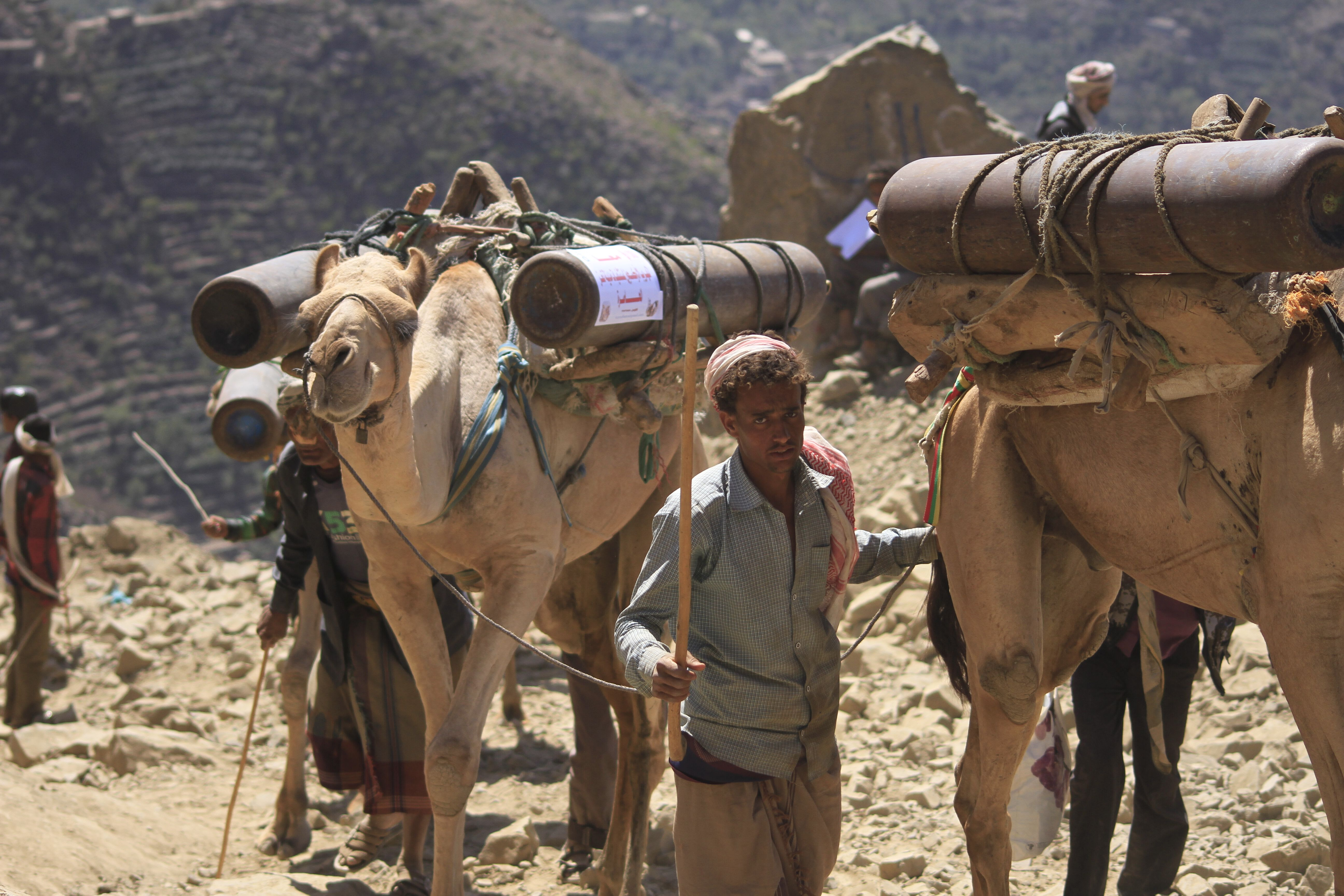 Smugglers bring oxygen canisters over the mountains into Taiz, a besieged city in Yemen.