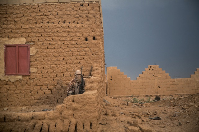 A member of the the CMA (Coordination des Mouvements de l'Azawad) secure the perimeter of the CMA HQ during the visit of Major General Michael Lollesgaard, Force Commander of the United Nations Multidimensional Integrated Stabilization Mission in Mali (MI